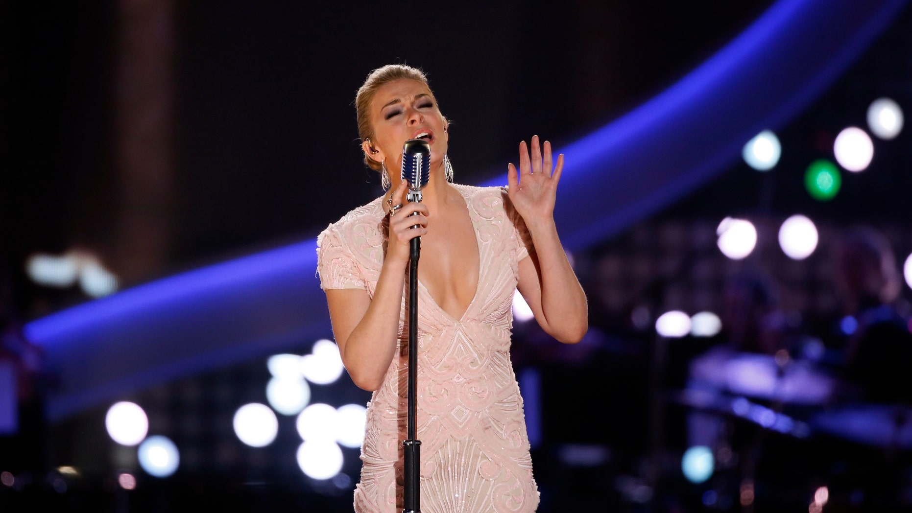 Singer Leann Rimes performs a medley of Patsy Cline songs during the 4th annual American Country Awards in Las Vegas, Nevada December 10, 2013.