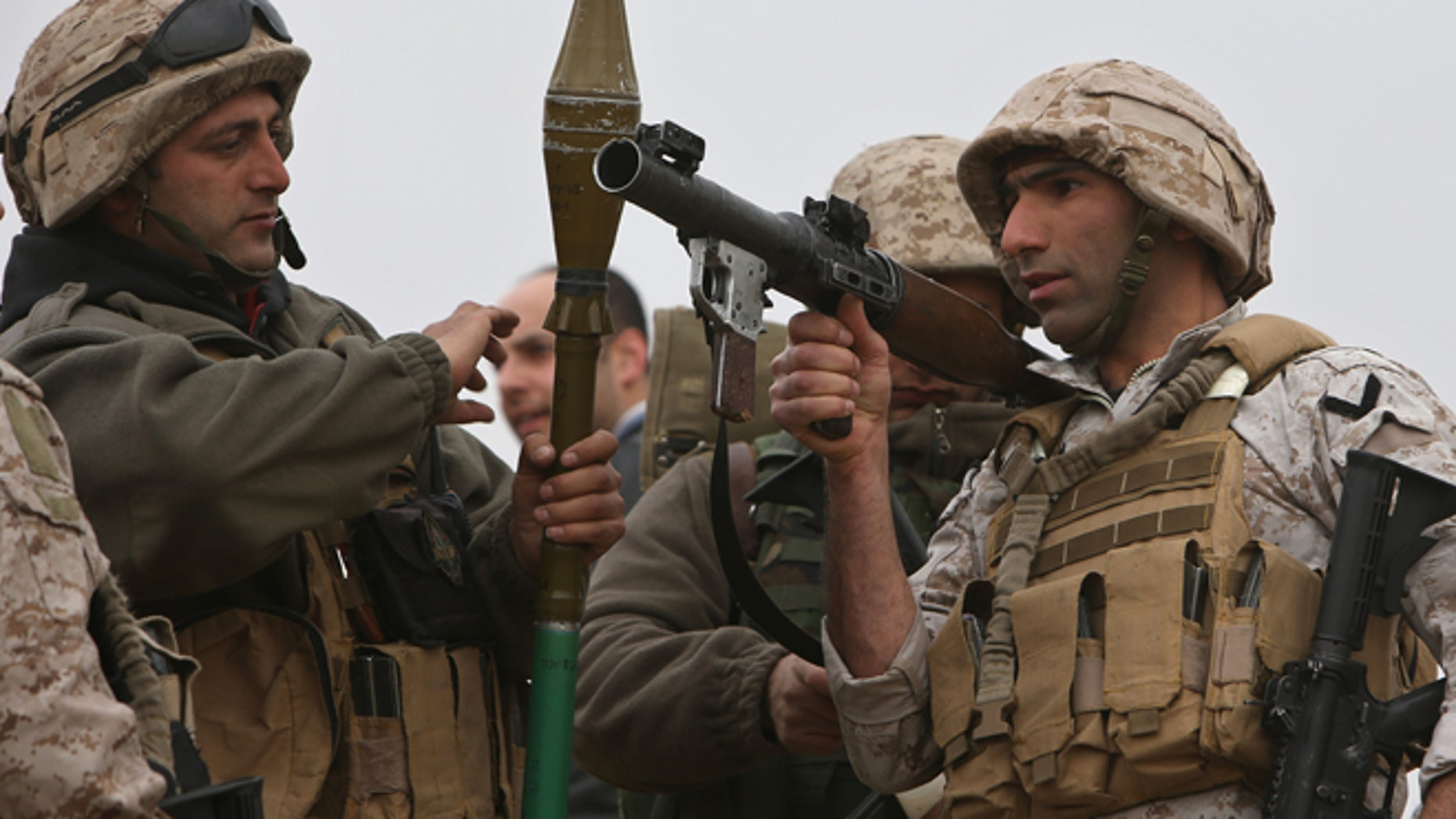 March 17, 2014: Lebanese army soldiers from a commandos unit, prepare to search an area where they blew up a bomb-packed parked car, in a field outside the village of Fakiha, near the Lebanese and Syria border, in northeast Lebanon.