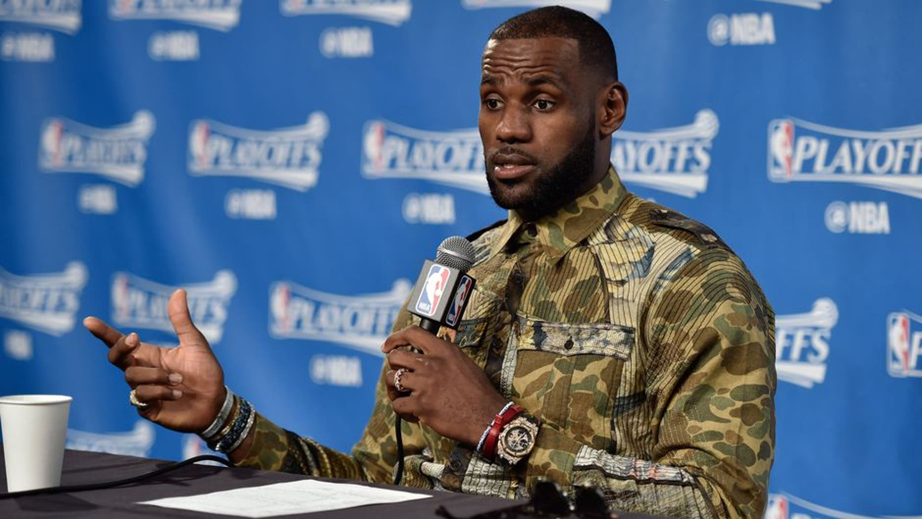 CLEVELAND, OH - MAY 1: LeBron James #23 of the Cleveland Cavaliers talks to the media during a press conference after Game One of the Eastern Conference Semifinals against the Toronto Raptors during the 2017 NBA Playoffs on May 1, 2017 at Quicken Loans Arena in Cleveland, Ohio. NOTE TO USER: User expressly acknowledges and agrees that, by downloading and/or using this photograph, user is consenting to the terms and conditions of the Getty Images License Agreement. Mandatory Copyright Notice: Copyright 2017 NBAE (Photo by David Liam Kyle/NBAE via Getty Images)