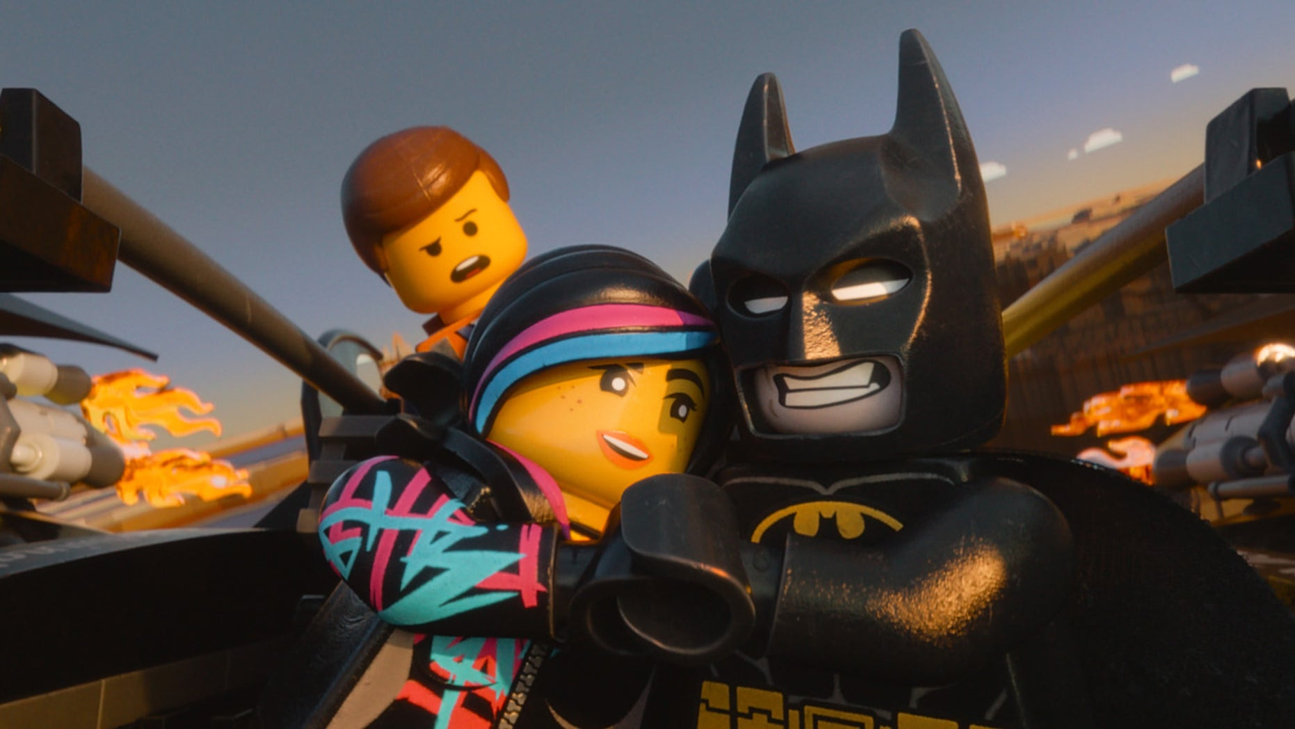 "This image released by Warner Bros. Pictures shows characters, from left, Emmet, voiced by Chris Pratt, Wyldstyle, voiced by Elizabeth Banks and Batman, voiced by Will Arnett, in a scene from ""The Lego Movie."""