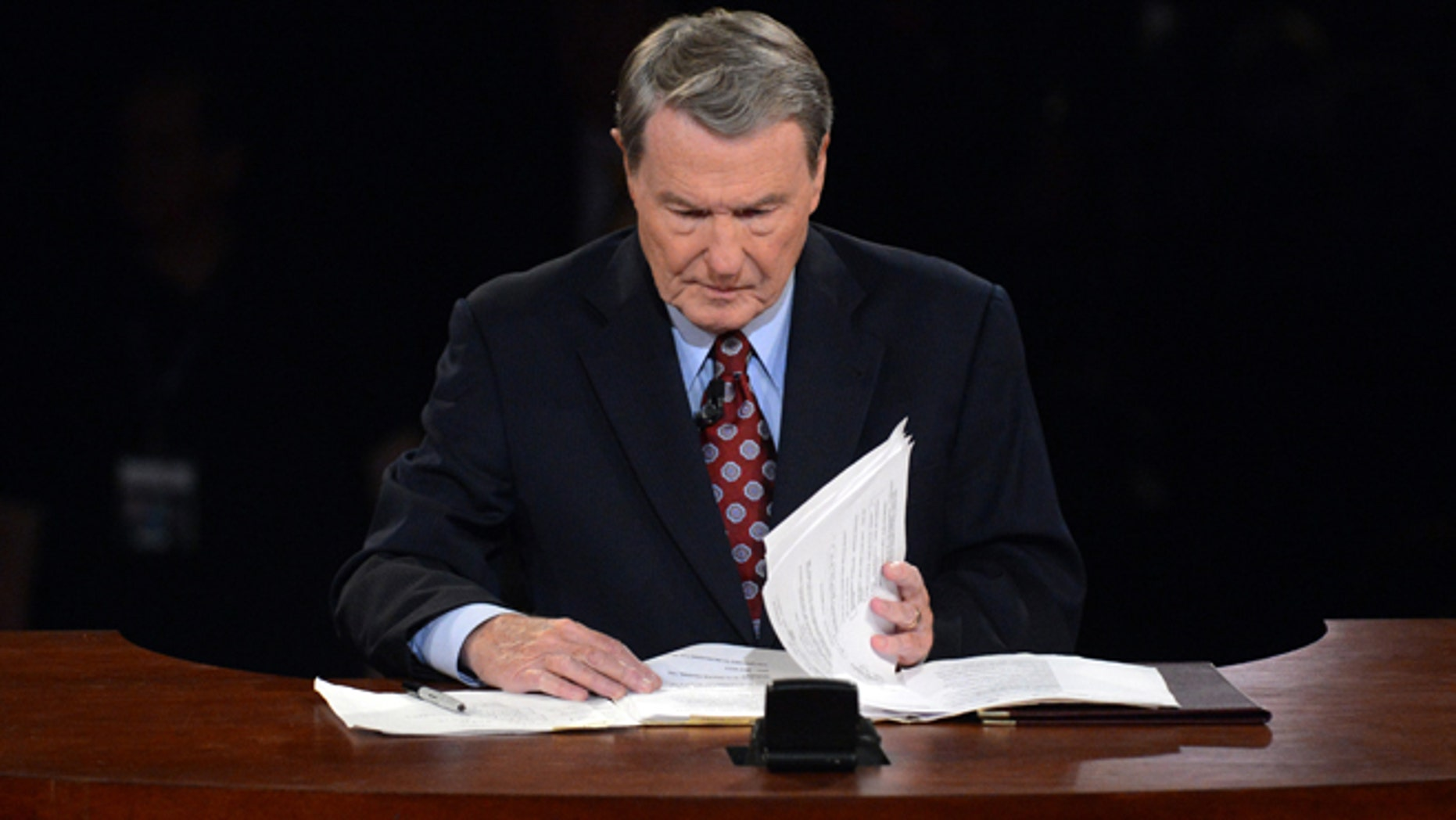 Oct. 3, 2012: Moderator Jim Lehrer looks over his notes before the first presidential debate.