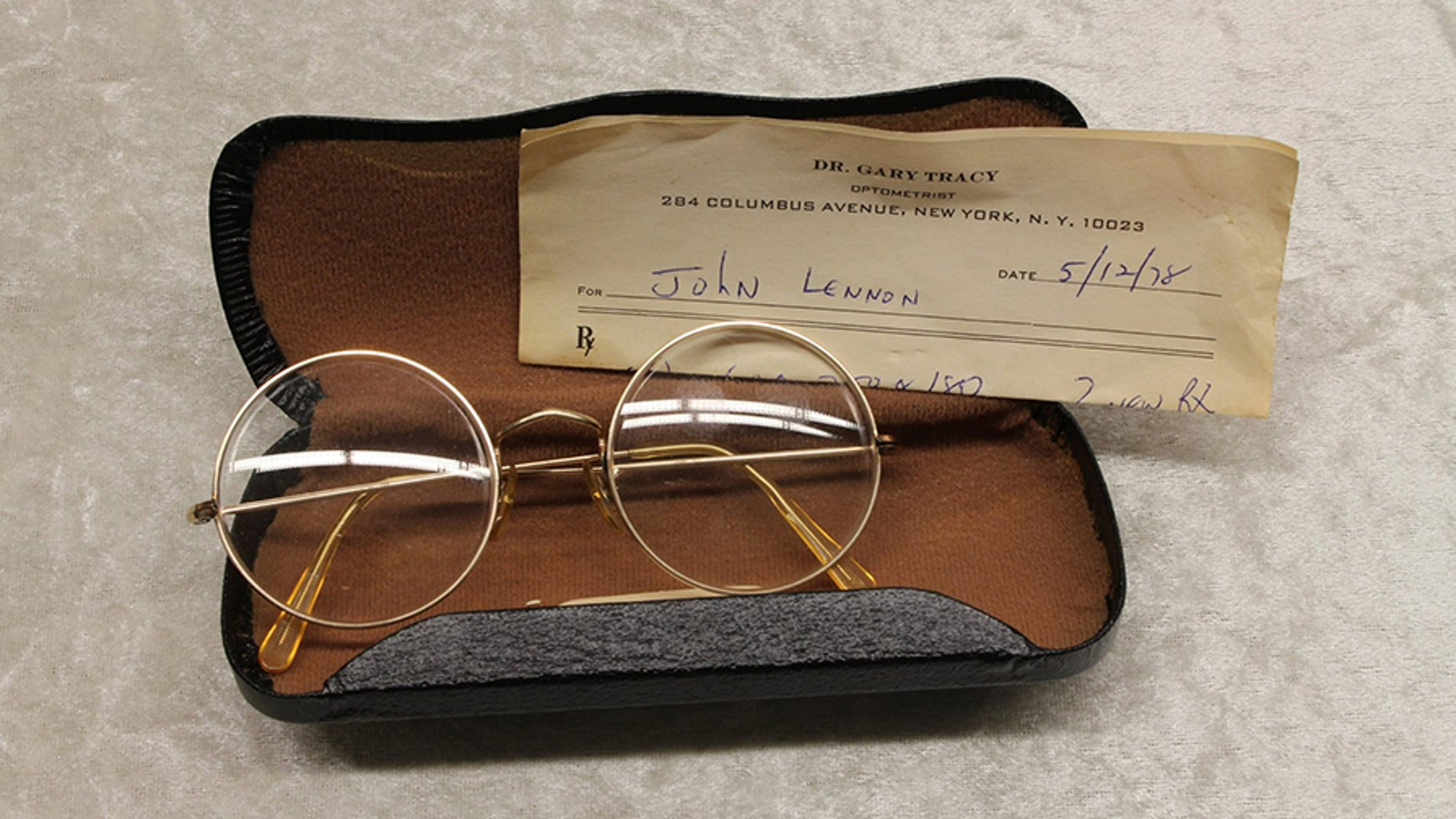 John Lennon's glasses with a prescription from optometrist Gary Tracy were displayed at the police headquarters in Berlin Tuesday.