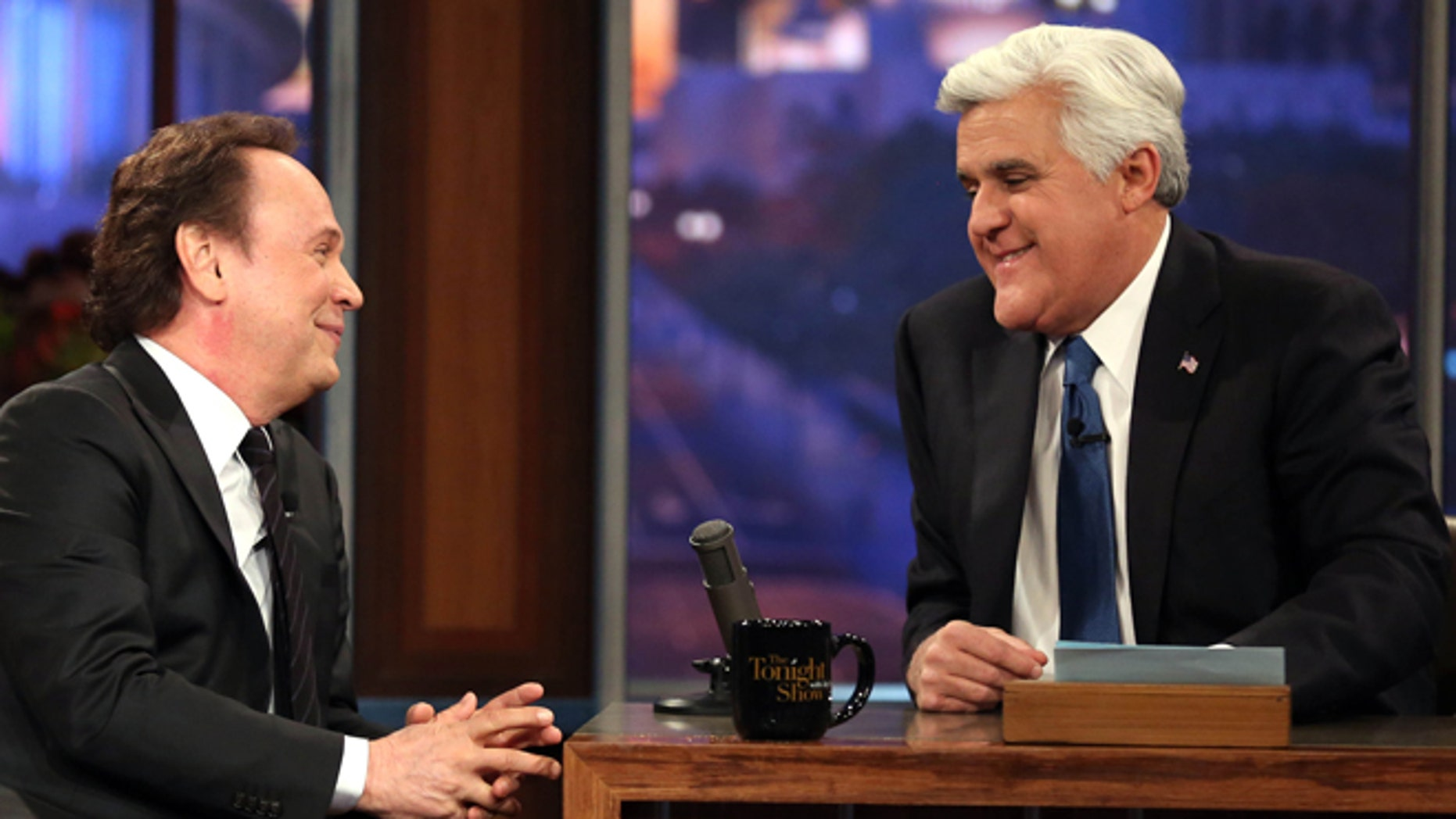"""Feb. 6, 2014: Billy Crystal, left, talks to host Jay Leno during the final taping of  NBC's The Tonight Show with Jay Leno,"""" in Burbank, Calif."""