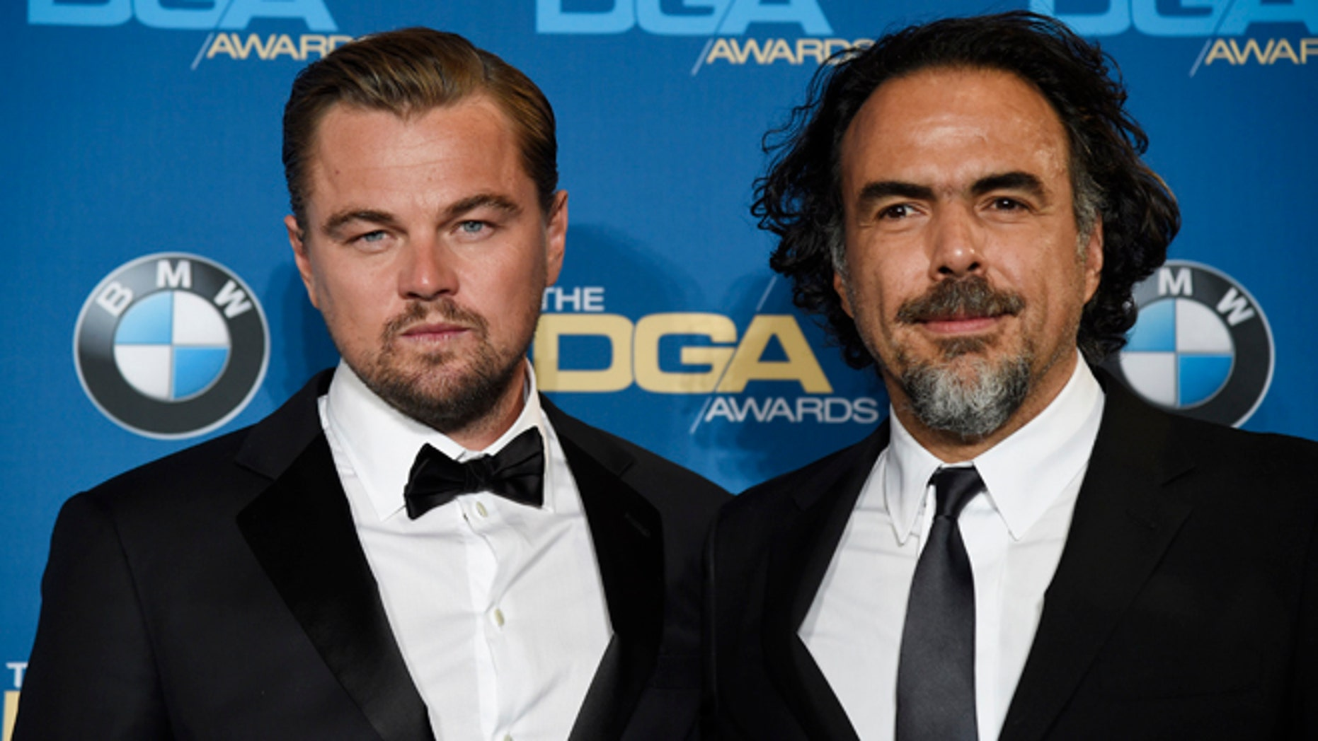 """Feb 6, 2016. Leonardo DiCaprio, left, star of  """"The Revenant,"""" poses backstage with the film's director Alejandro Gonzalez Inarritu at the 68th Directors Guild of America Awards in Los Angeles."""
