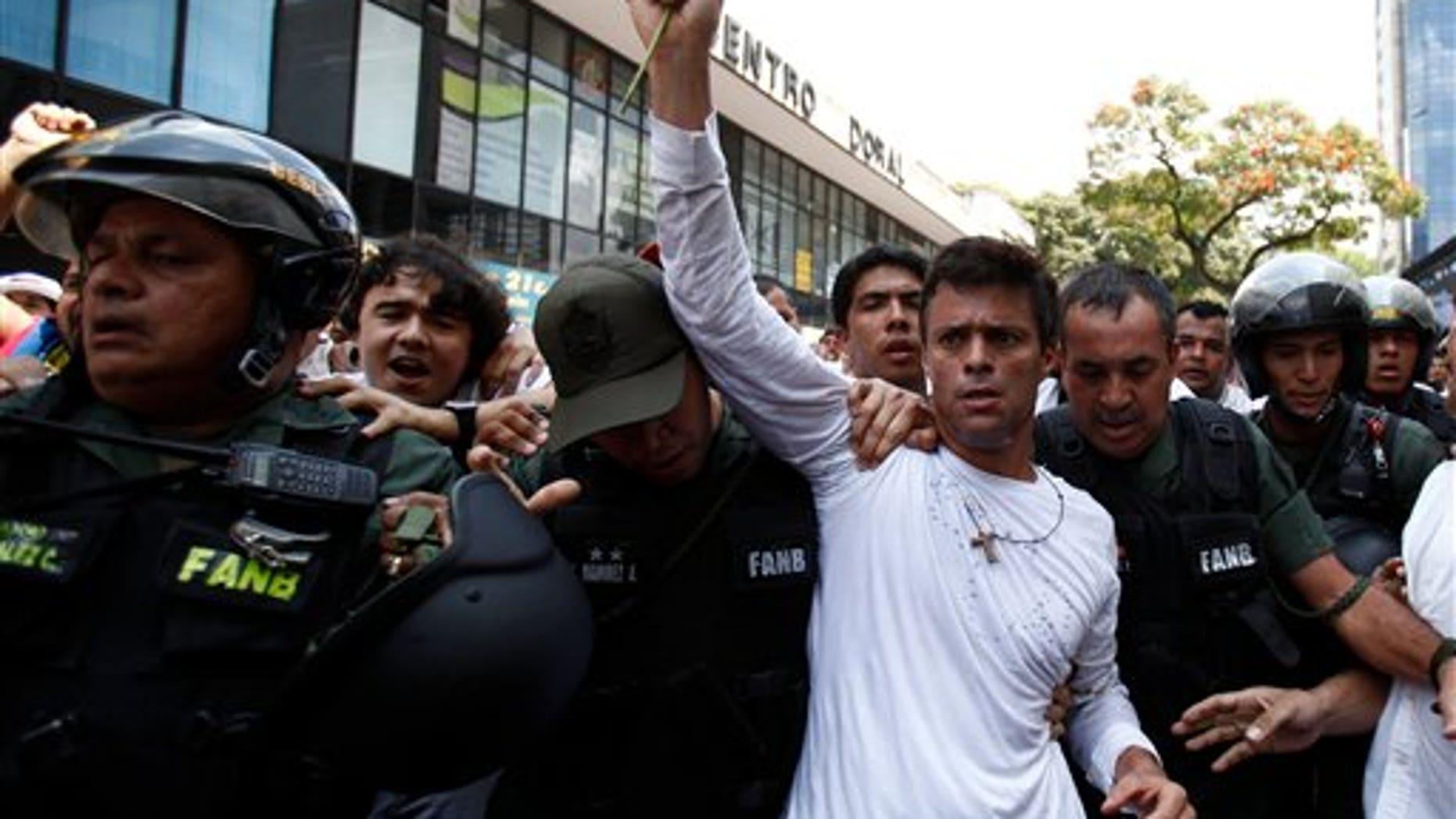 Leopoldo Lopez is taken into custody by Bolivarian National Guards in Caracas, Venezuela, on Feb. 18, 2014.