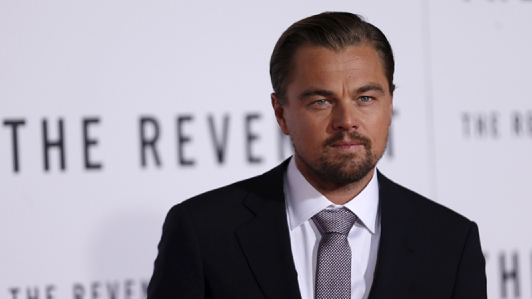 """Jan 8, 2016. Leonardo DiCaprio poses at the premiere of """"The Revenant"""" in Hollywood, CA."""