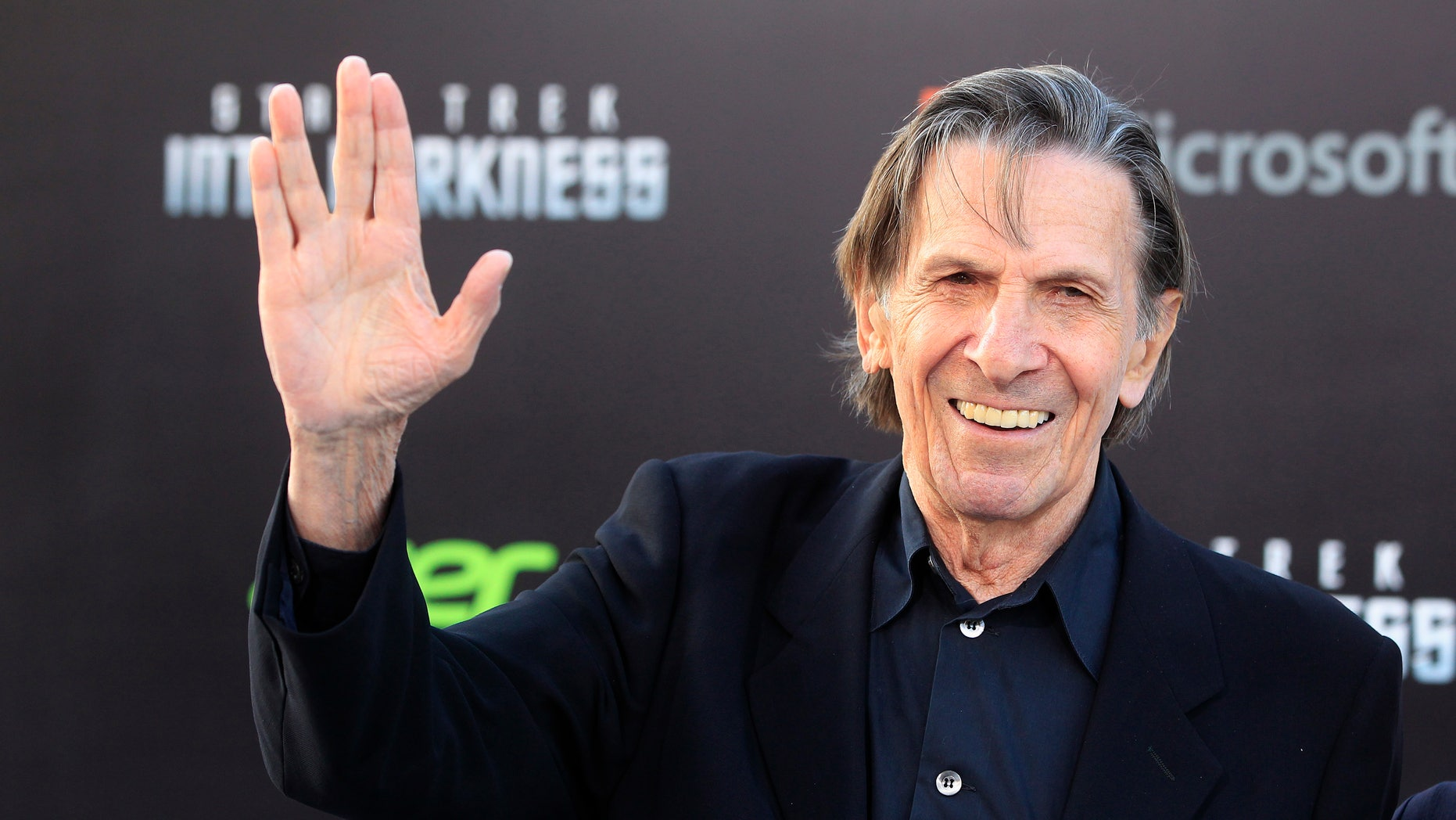 """May 14, 2013. Leonard Nimoy, cast member of the new film """"Star Trek Into Darkness,"""" poses as he arrives at the film's premiere in Hollywood."""