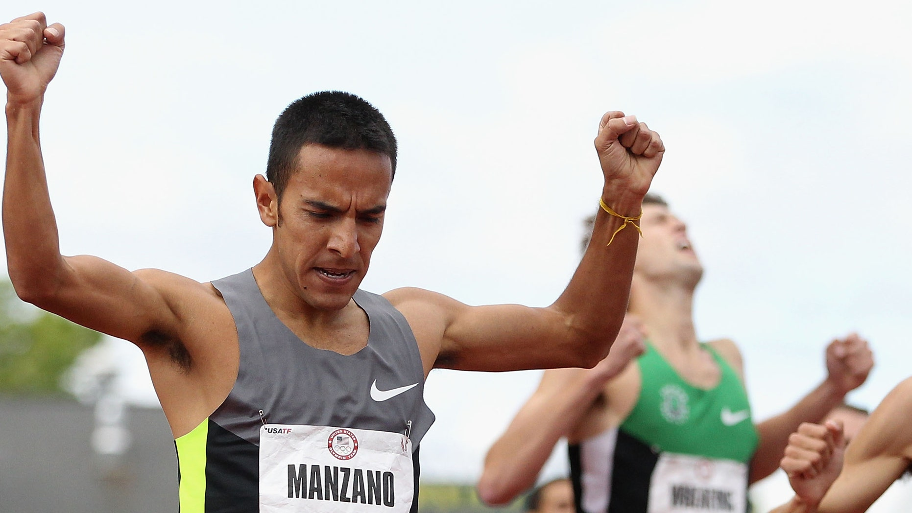 EUGENE, OR - JULY 01:  Leonel Manzano celebrates as he crosses the finish line to win the Men's 1500 Meter Run Final on day ten of the U.S. Olympic Track & Field Team Trials at the Hayward Field on July 1, 2012 in Eugene, Oregon.  (Photo by Christian Petersen/Getty Images)