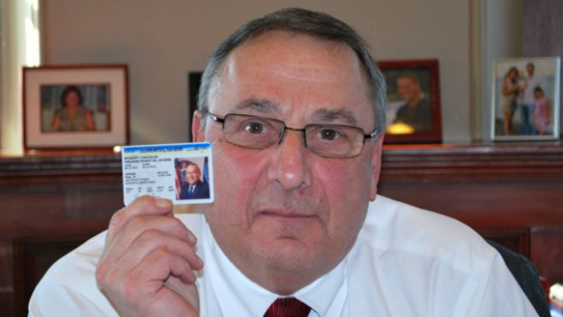 Feb. 12, 2013: In this photo tweeted by Gov. Paul LePage, the Maine governor displays his concealed firearms permit.