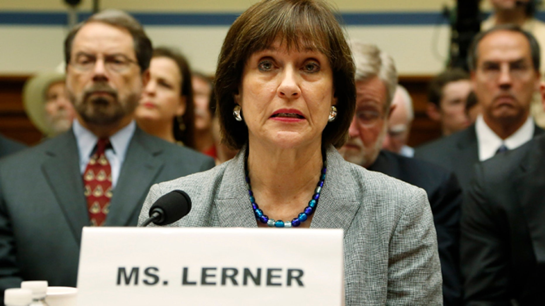 May 22, 2013: Director of Exempt Organizations for the Internal Revenue Service (IRS) Lois Lerner prepares to deliver an opening statement to a House Oversight and Government Reform Committee hearing on alleged targeting of political groups seeking tax-exempt status from by the IRS, on Capitol Hill in Washington