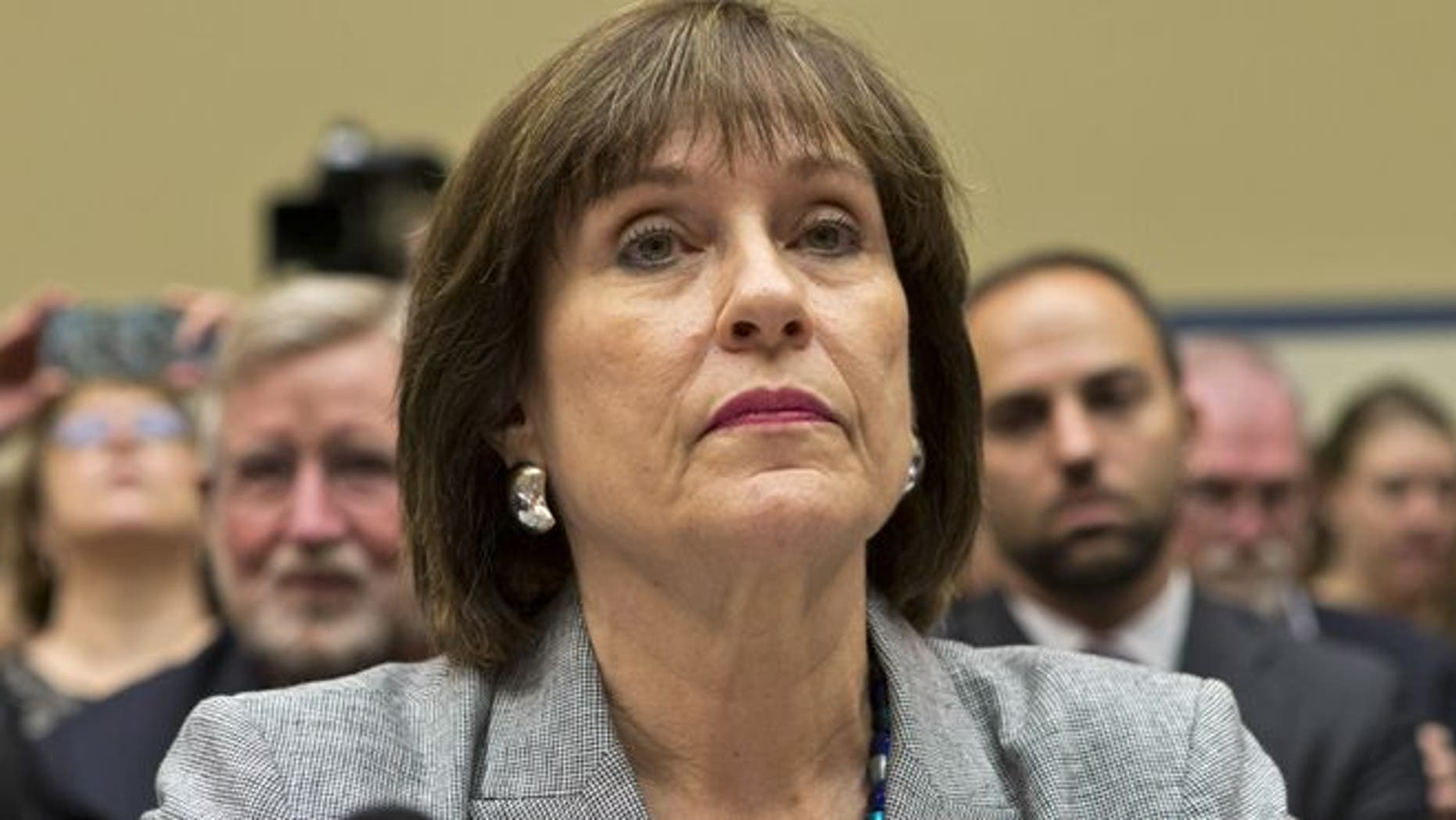 May 22, 2013: Lois Lerner, head of the IRS unit that decides whether to grant tax-exempt status to groups, listens on Capitol Hill in Washington.