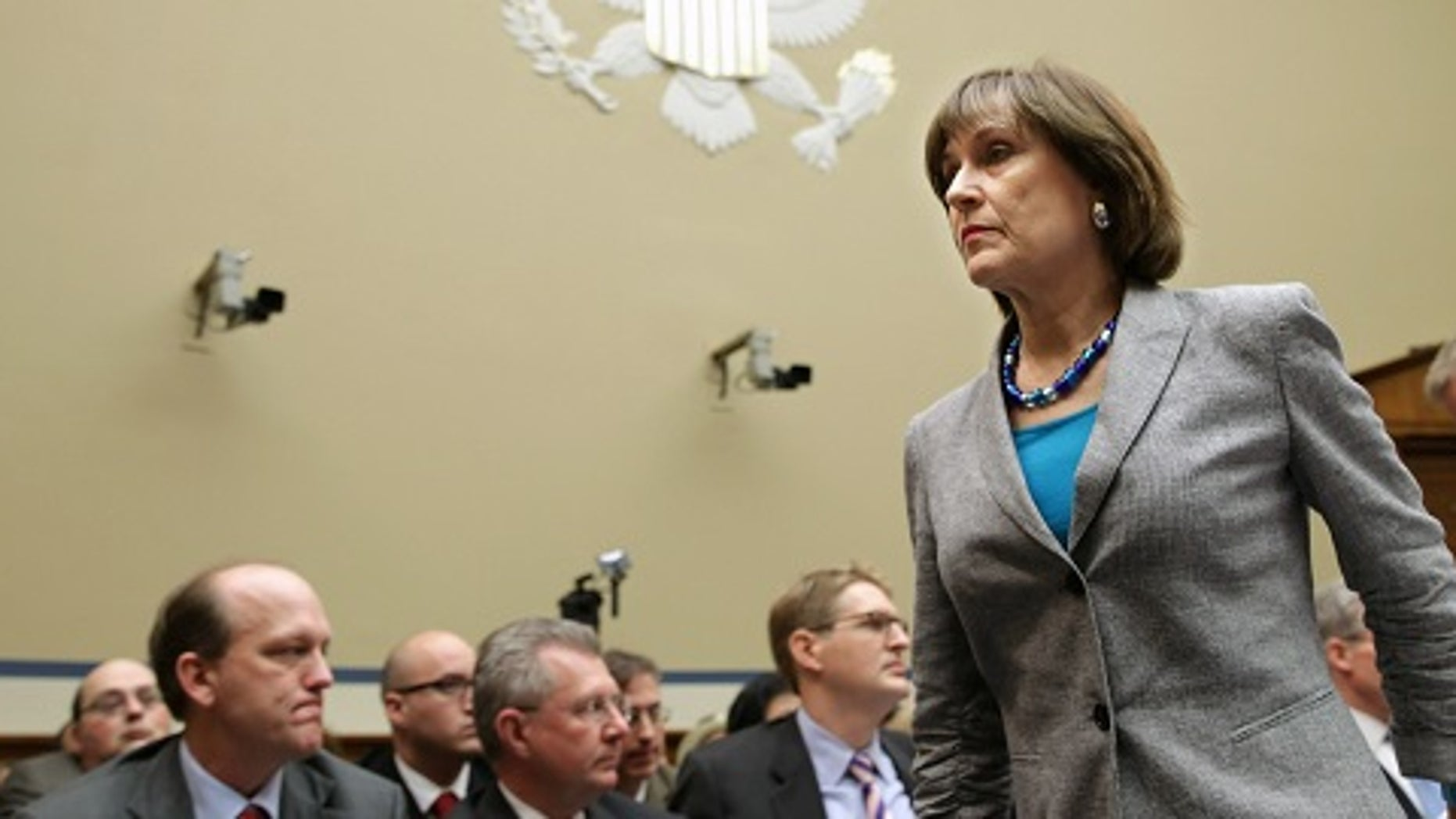 """WASHINGTON, DC - MAY 22:  Internal Revenue Service Director of Exempt Organizations Lois Lerner leaves a hearing of the House Oversight and Government Reform Committee after refusing to testify May 22, 2013 in Washington, DC. The committee is investigating allegations that the IRS targeted conservative non-profit organizations with the words """"tea party"""" and """"constitution"""" in their names for additional scrutiny. Lerner, who headed the division that oversees exempt organizations, exercised her constitutional right not to answer questions.  (Photo by Chip Somodevilla/Getty Images)"""