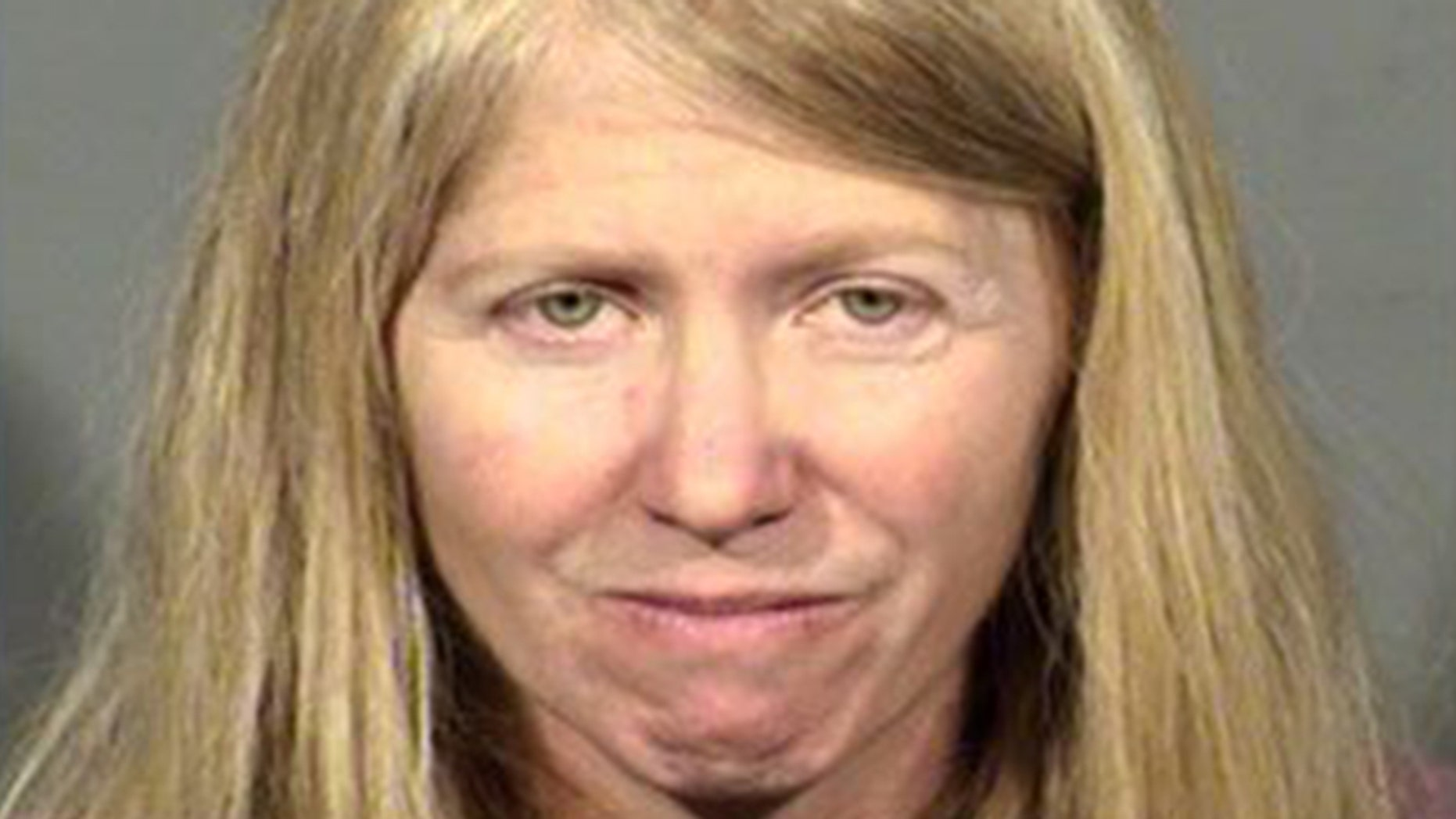 Mugshot for Leslie McGourty charged this month with threatening to shoot up a concert.