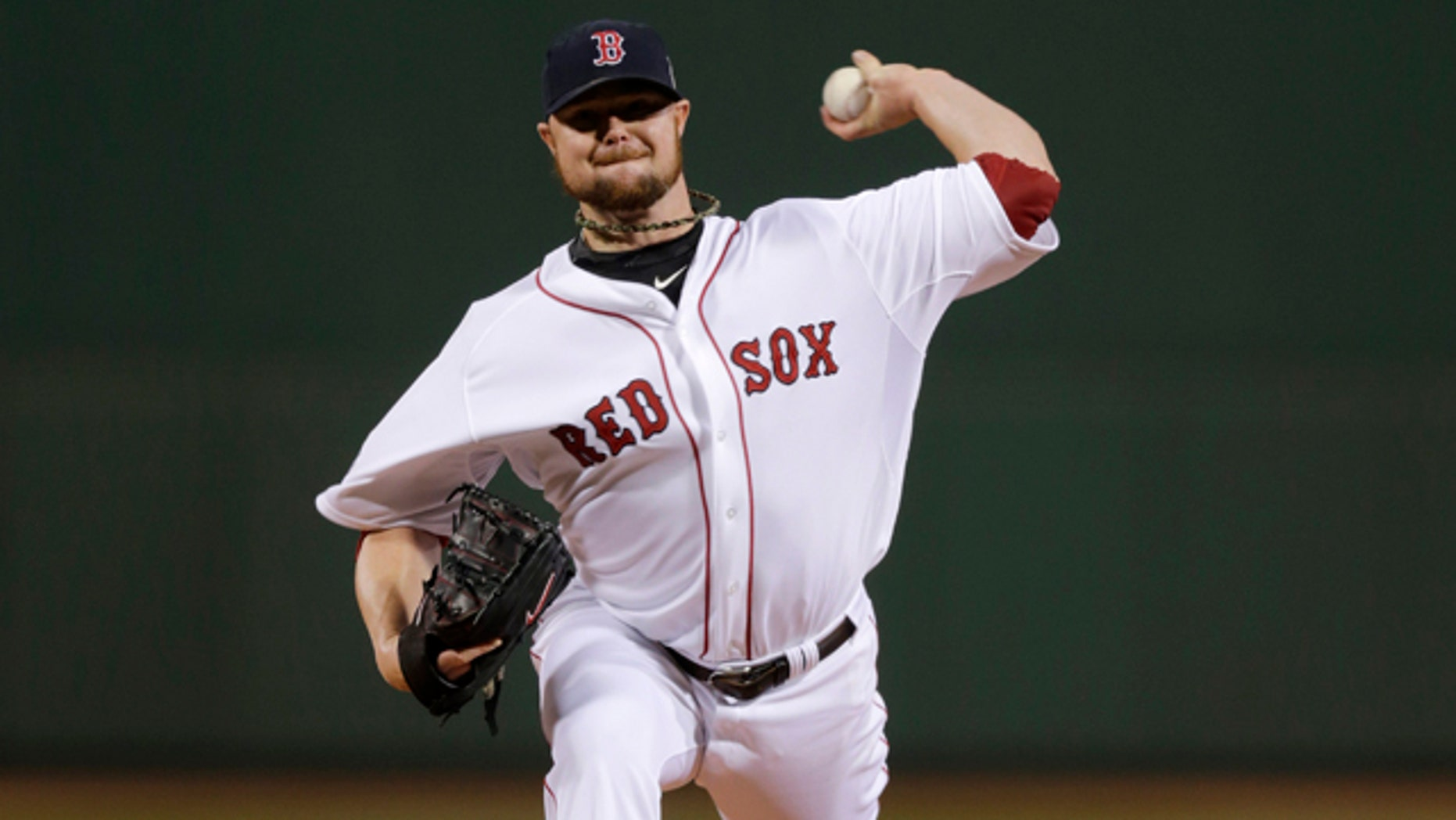 Oct. 23, 2013: Boston Red Sox starting pitcher Jon Lester throws during the first inning of Game 1 of baseball's World Series against the St. Louis Cardinals.