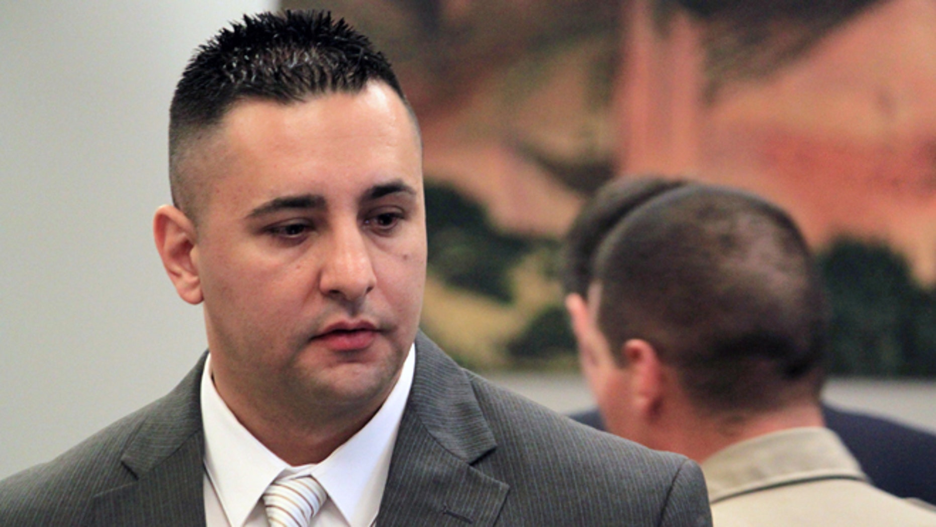 June 10, 2013: Former Albuquerque Police Officer Levi Chavez prepares to leave the courtroom following opening statements in his trial in Bernalillo, N.M. (AP/Susan Montoya Bryan, File)