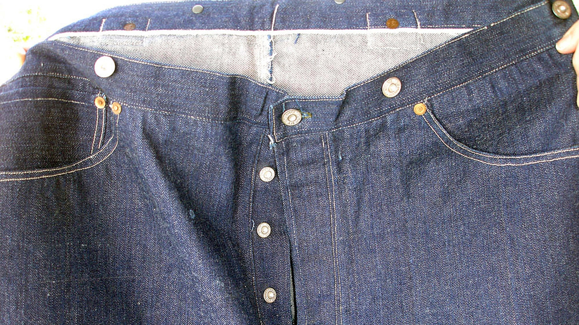 This undated photo provided by Daniel Buck Auctions, of Lisbon Falls, Maine, shows a portion of a pair of 125-year-old Levi Strauss & Co., denim blue jeans that sold for nearly $100,000 this month. The buyer was from Asia.
