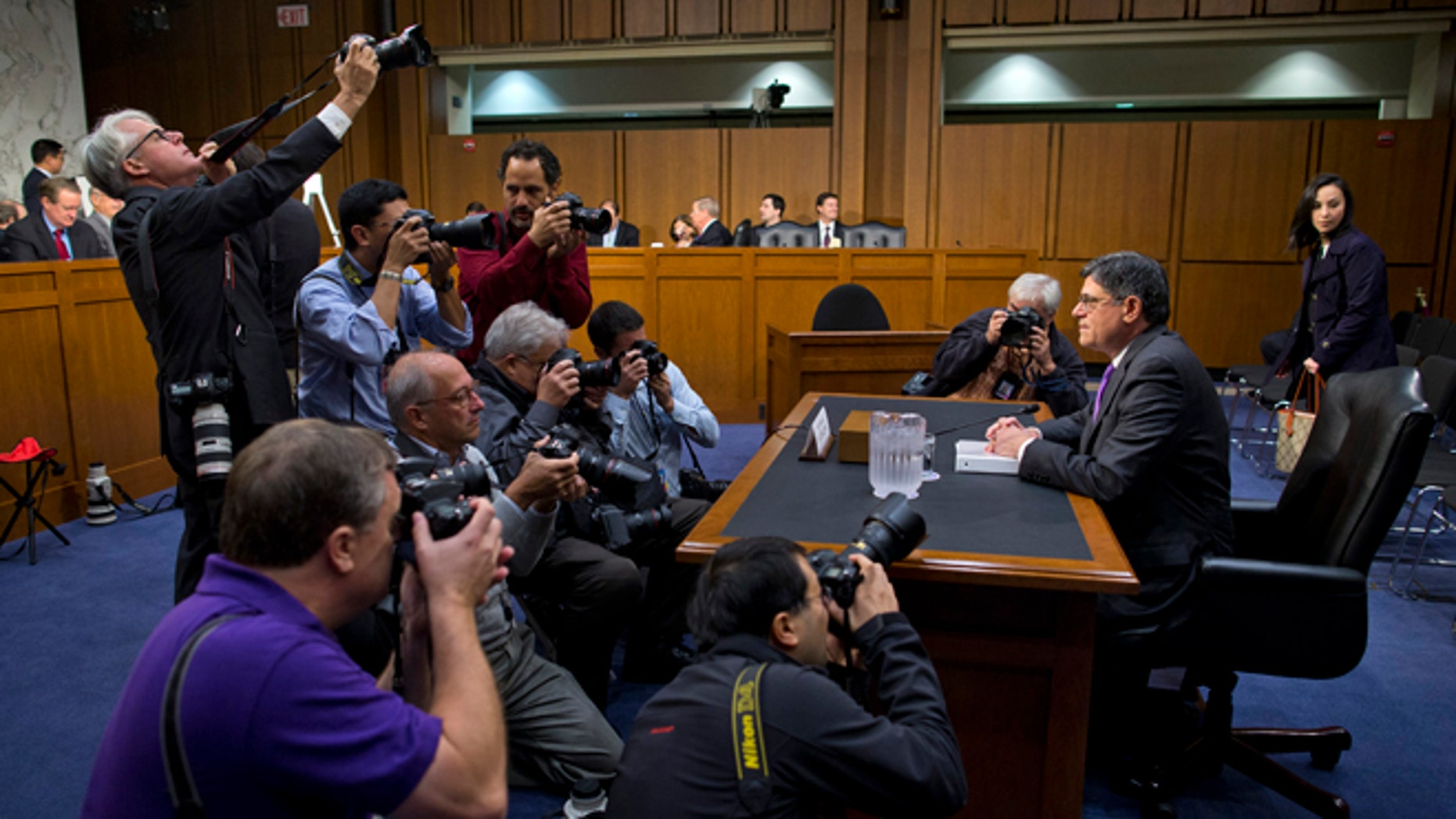Oct. 10, 2013: Treasury Secretary Jacob Lew is surrounded by photographers prior to testifying on Capitol Hill in Washington.
