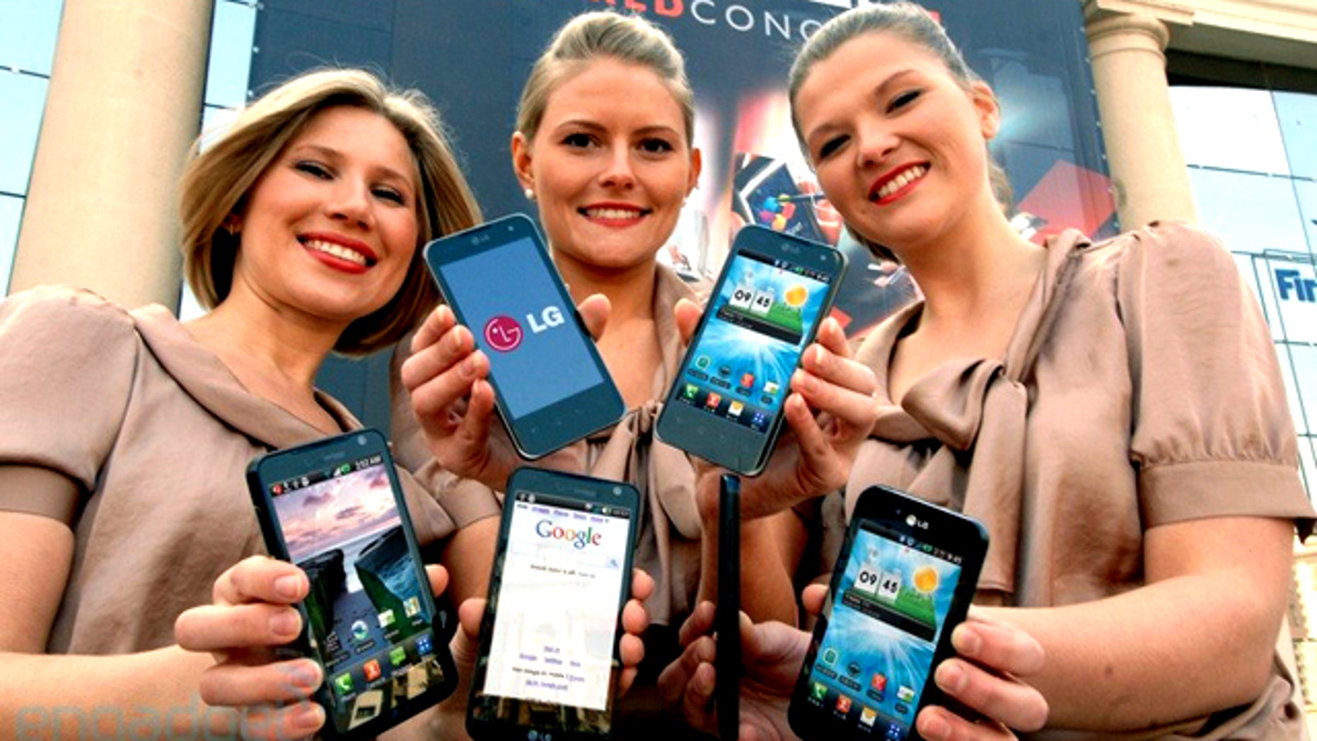 Models show off LG's new 3D phone at the Mobile World Congress 2011 show in Barcelona.