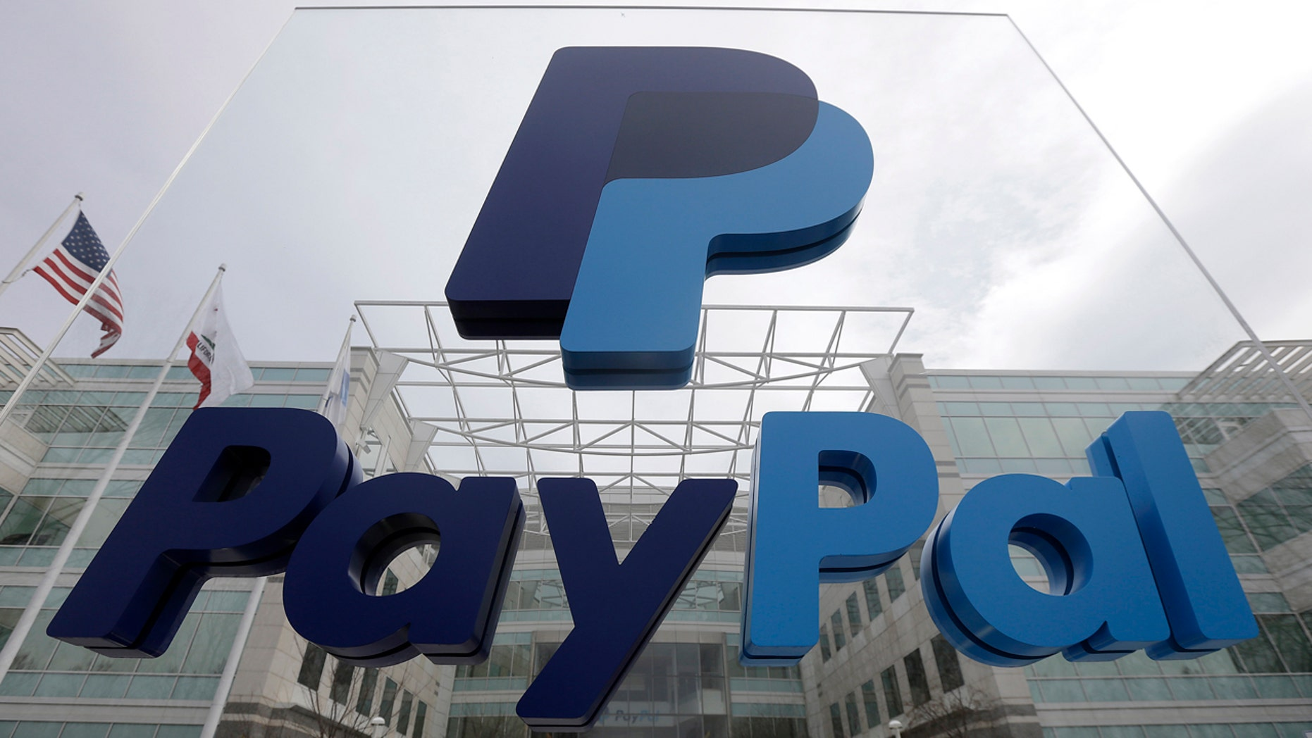FILE - This March 10, 2015, file photo, shows signage outside PayPal's headquarters in San Jose, Calif.