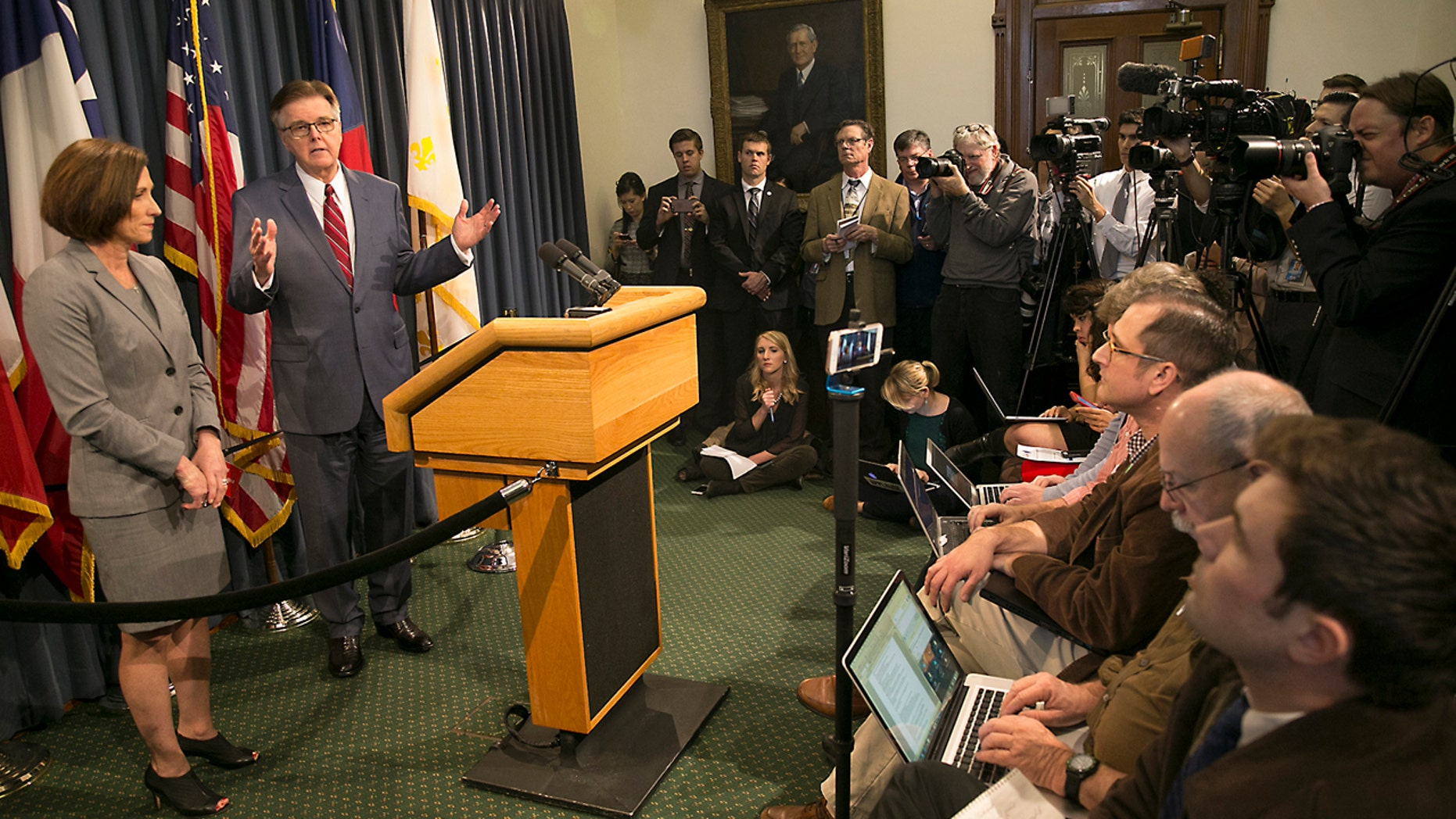Texas Lt. Gov. Dan Patrick and Senator Lois Kolkhorst introduced Senate Bill 6 known as the Texas Privacy Act, which provides solutions to the federal mandate of transgender bathrooms, showers and dressing rooms in all Texas schools. The two legislators answer questions from a press availability Thursday, Jan. 5, 2017, in the Senate Conference room at the State Capitol in Austin, Texas. (Ralph Barrera/Austin American-Statesman via AP)