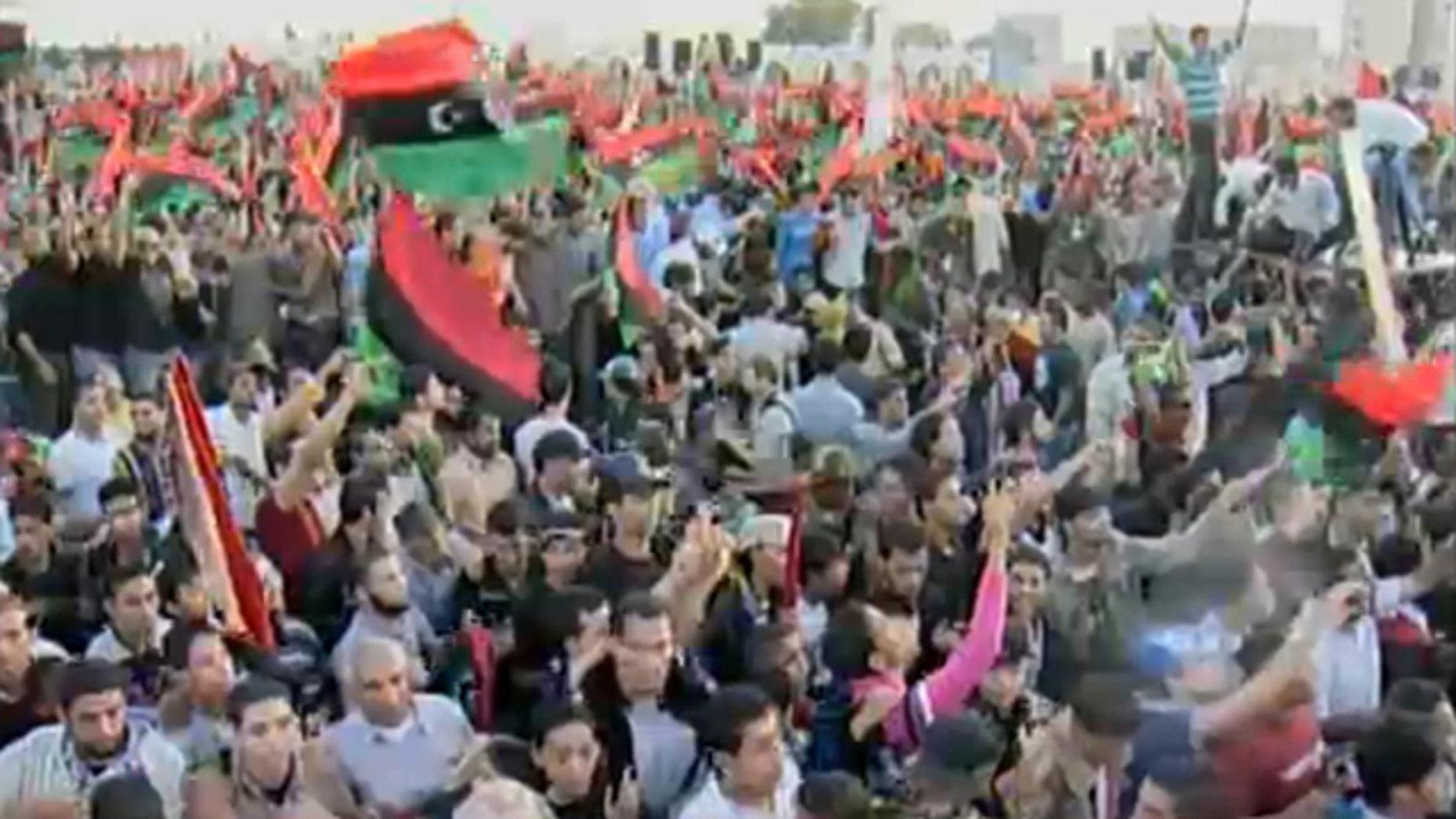 Oct. 23, 2011: In this image taken from video, Libyans cheer as the National Transitional Council declares Libya's liberation after an eight-month civil war.