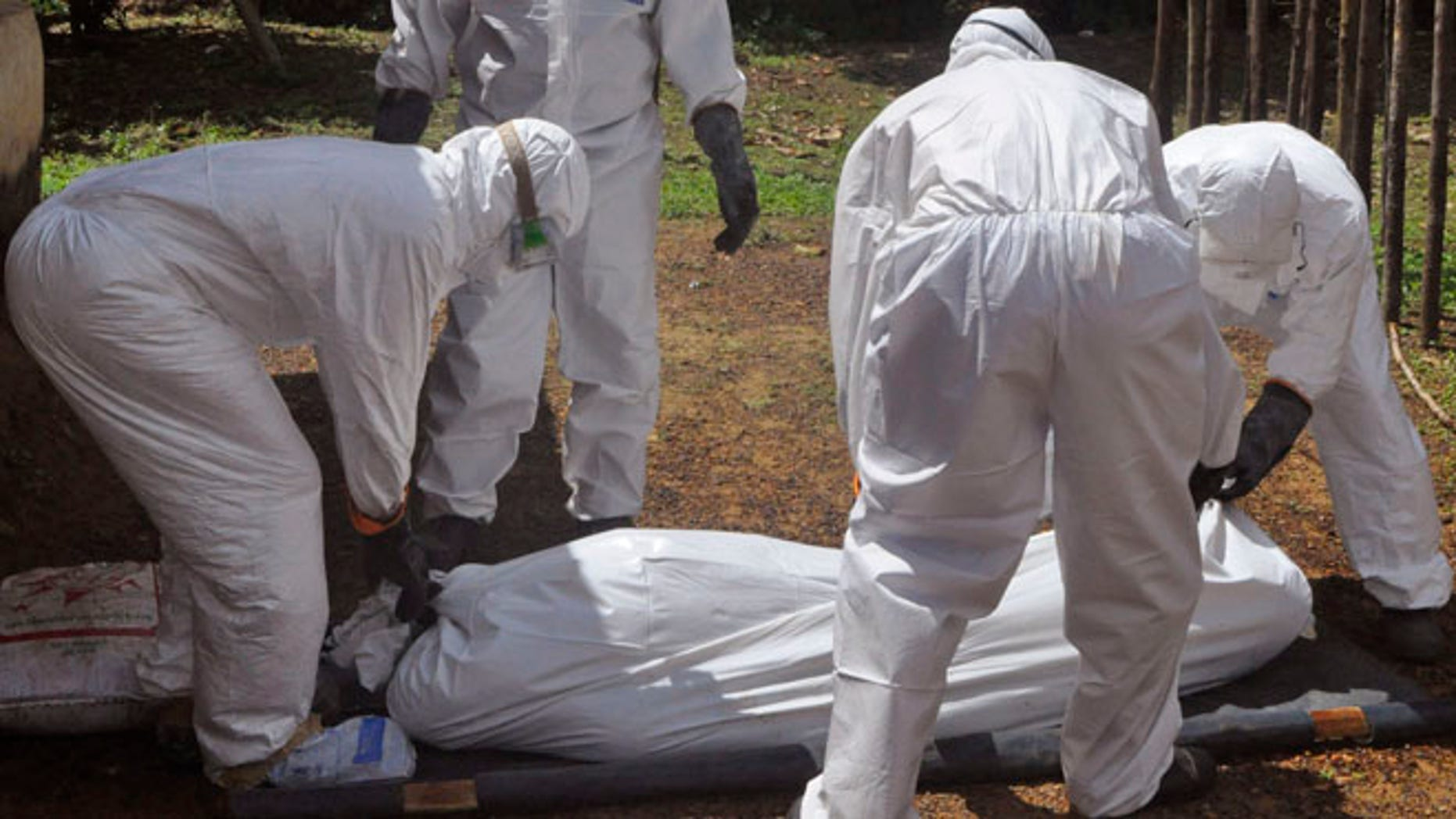 Oct. 20, 2014: Health workers carry the body of a woman suspected of contracting the Ebola virus in Bomi county situated on the outskirts of Monrovia, Liberia.