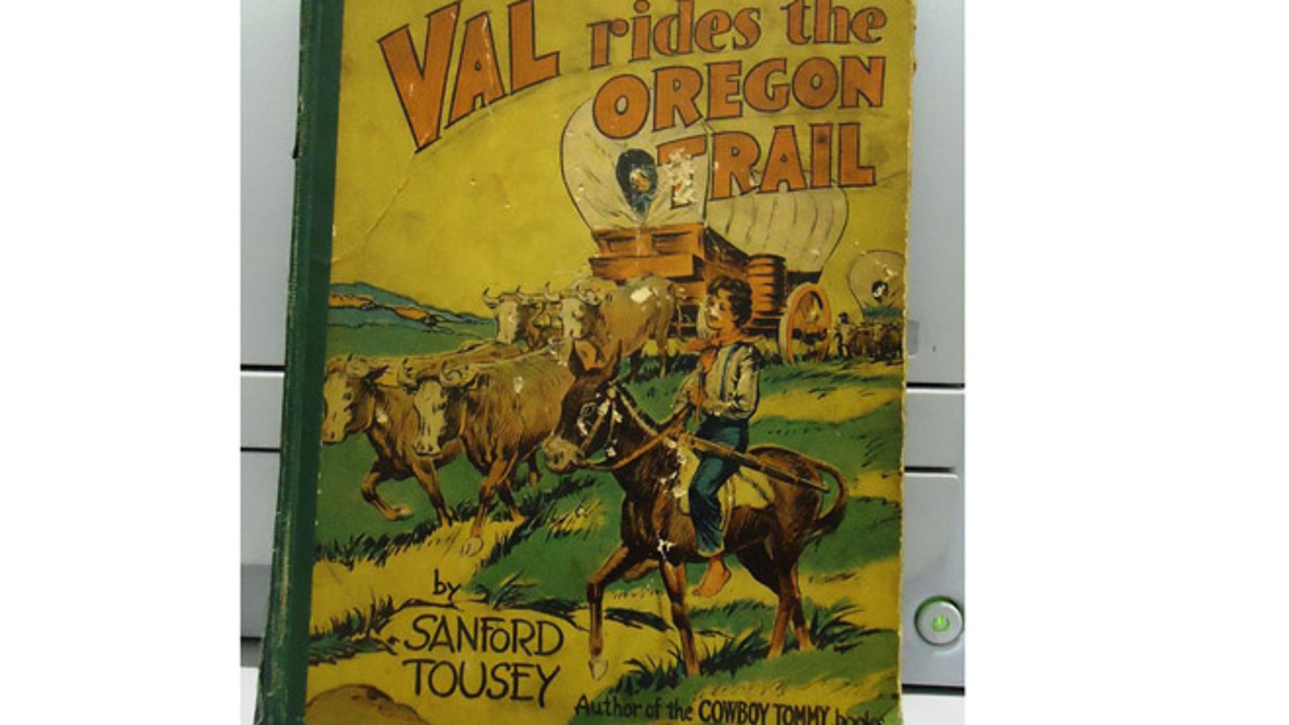 """Robert Lockman Jr. found the book """"Val Rides the Oregon Trail"""" in the basement of his home."""