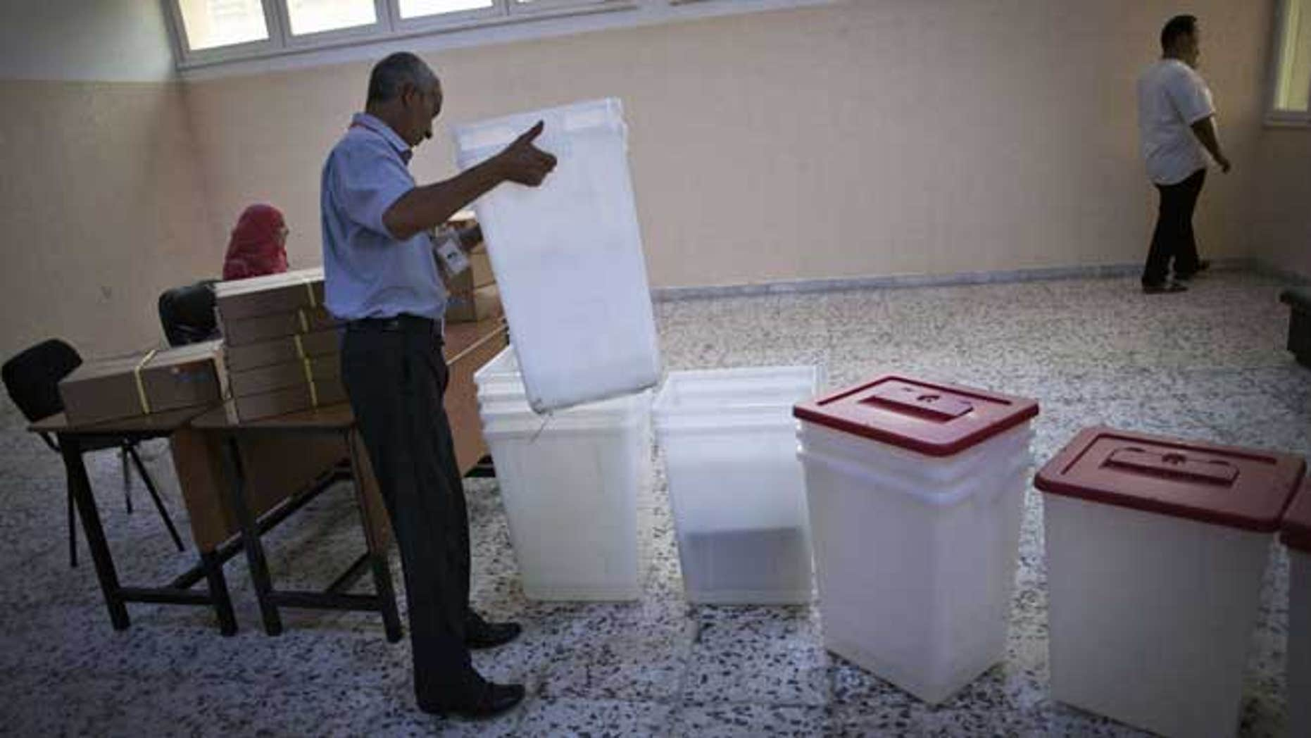 July 6, 2012: A Libyan election official works at a polling station in Tripoli, Libya. The Libyan National Assembly elections - the first free election since 1969-will take place on July 7, 2012.