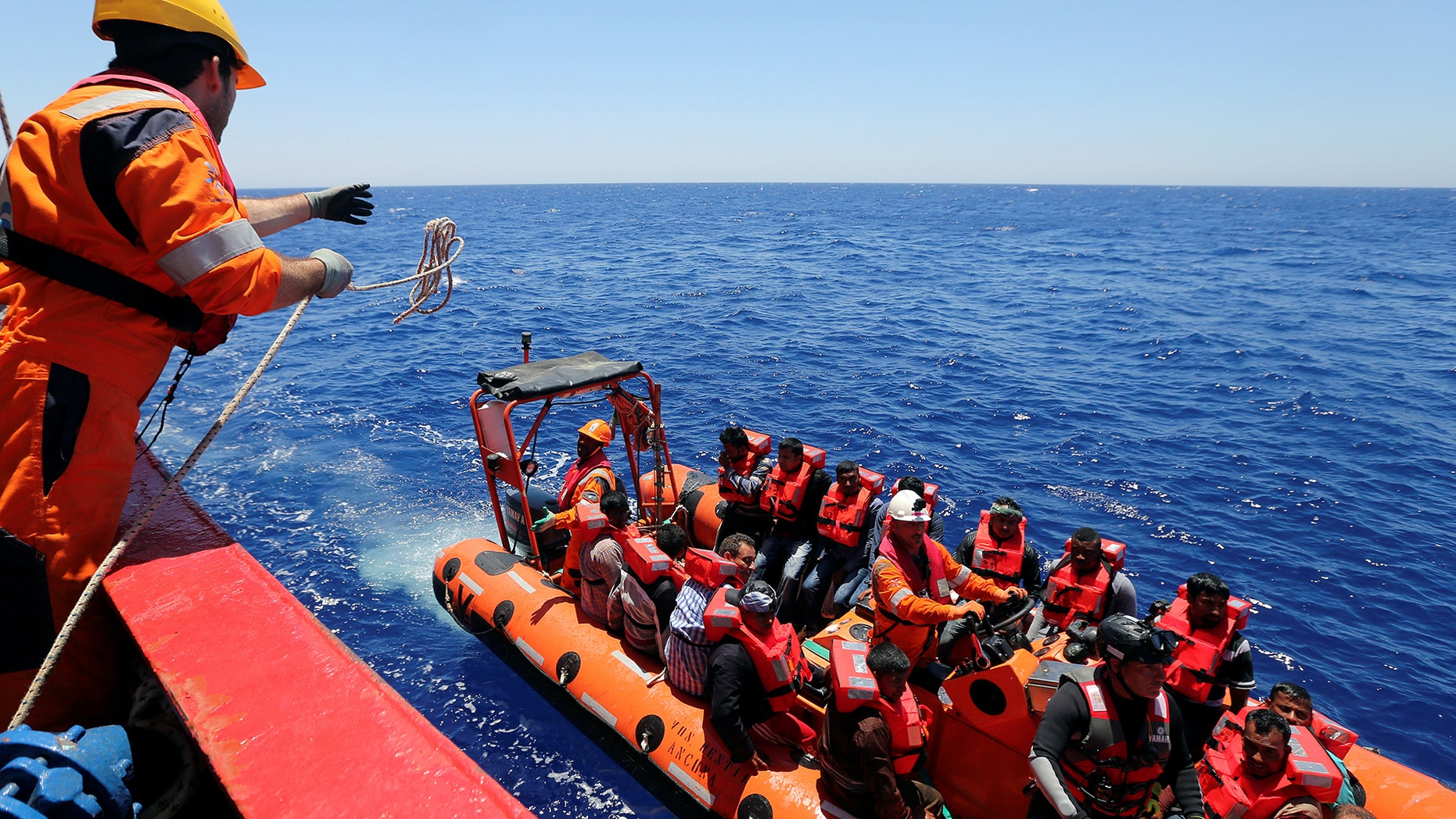 """Migrants are rescued by """"Save the Children"""" NGO crew from the ship Vos Hestia in the Mediterranean sea off Libya coast, June 15, 2017.  REUTERS/Stefano Rellandini - RTS1792D"""