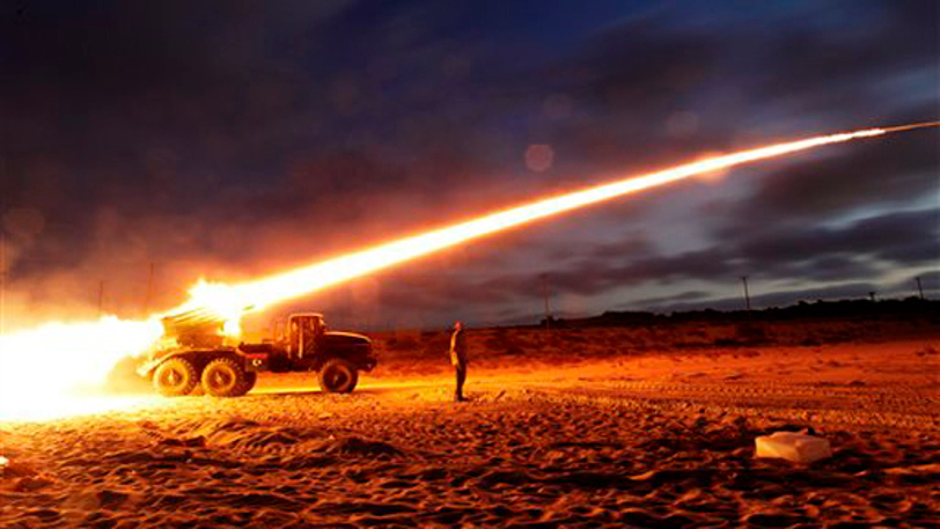 June 20: Rebel fighters fire a rocket at the front line west of Misrata, Libya.