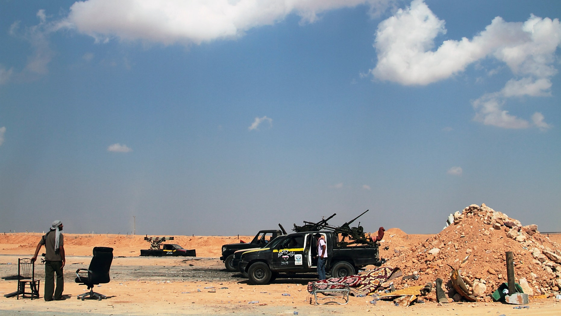Aug. 27: Libyan rebels are seen on the road out of Misrata, 118 miles from Sirte, Libya.