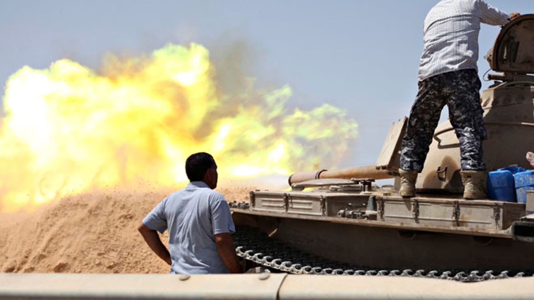 Aug 22, 2014: A tank belonging to the Western Shield, a branch of the Libya Shield forces, fires during a clash with rival militias around the former Libyan army camp, Camp 27, in the 27 district, west of Tripoli. (Reuters)