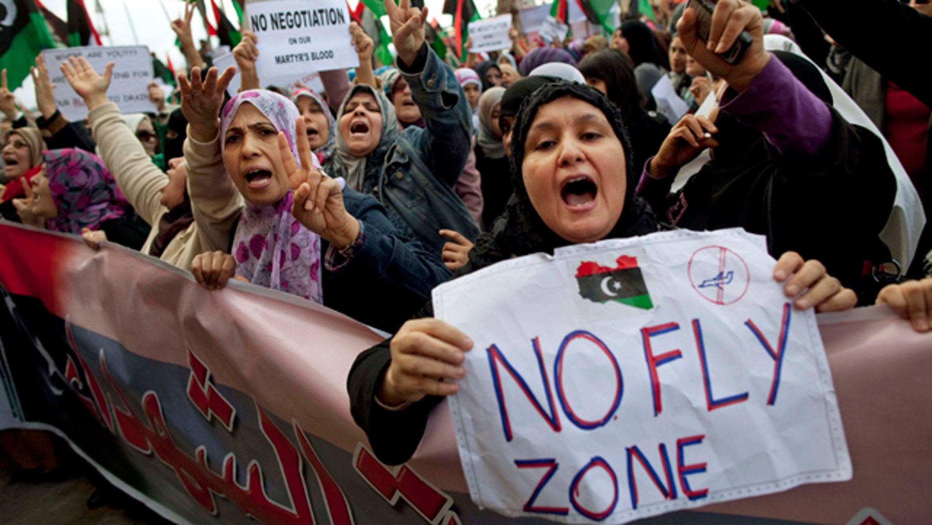 March 9, 2011: Libyan women protest to demand the resignation of Libyan leader Muammar al-Qaddafi and for a no-fly zone during a demonstration in Benghazi, eastern Libya.