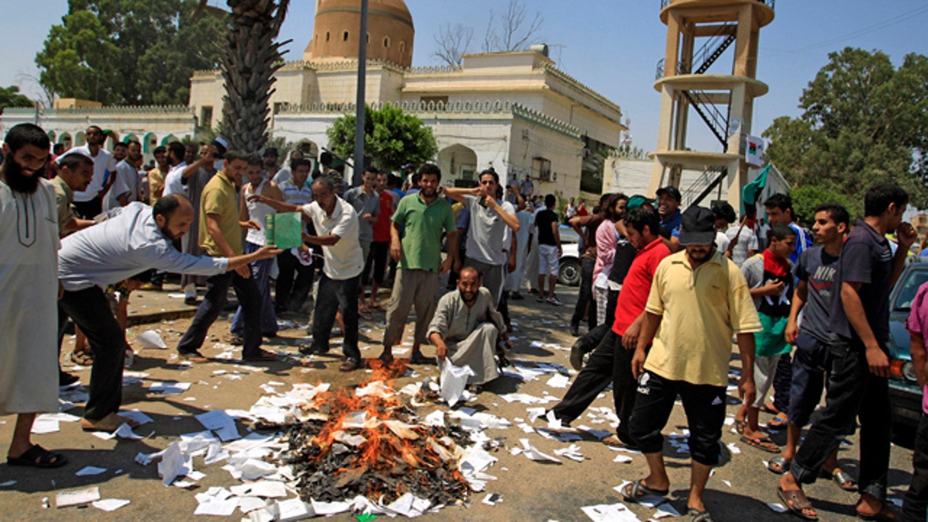 Aug. 27: Rebel supporters burn Green books in the main square of the Qasr Bin Ghashir district in Tripoli, Libya.