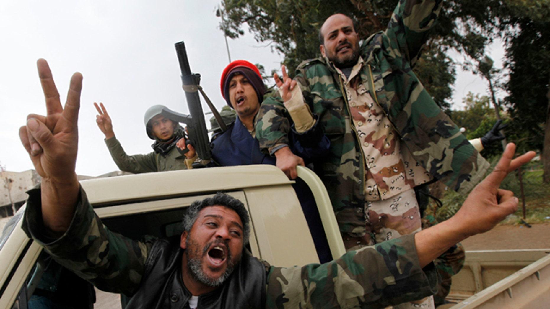 Feb. 27, 2011: Anti-Lybian leader gunmen celebrate the freedom of the Libyan city of Benghazi, Libya. U.S. President Barack Obama has called on Libyan dictator Muammar Qaddafi to leave power immediately.
