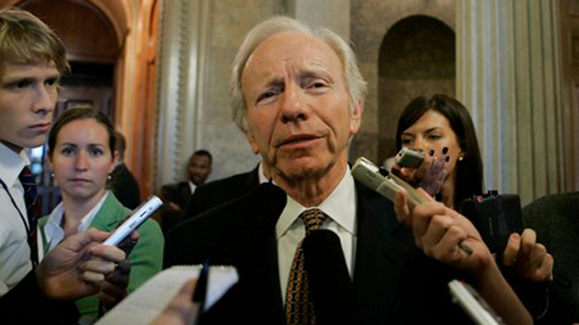 Sen. Joseph Lieberman speaks to reporters on Capitol Hill in Washington Oct. 27. (AP Photo)