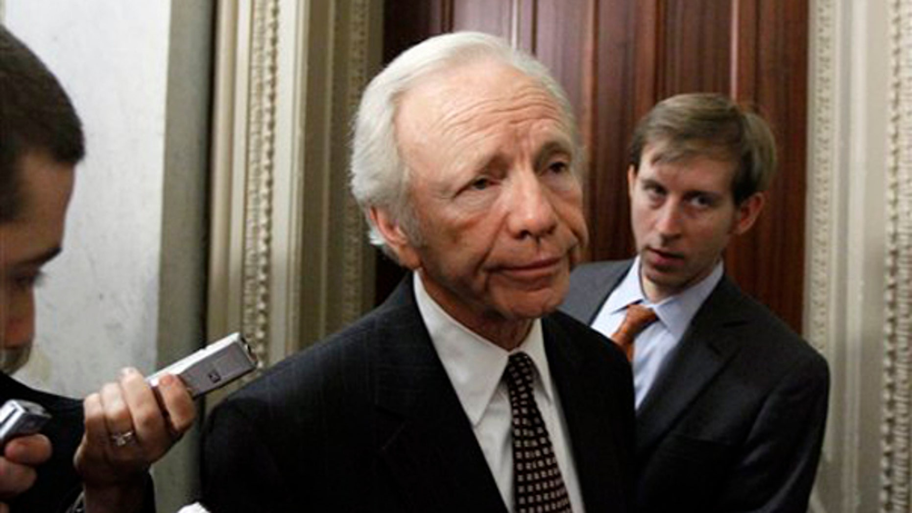 Sen. Joe Lieberman, I-Conn., pauses before heading into a Democratic caucus on health care reform in the Capitol in Washington, Wednesday, Nov. 18, 2009.(AP Photo/Alex Brandon)
