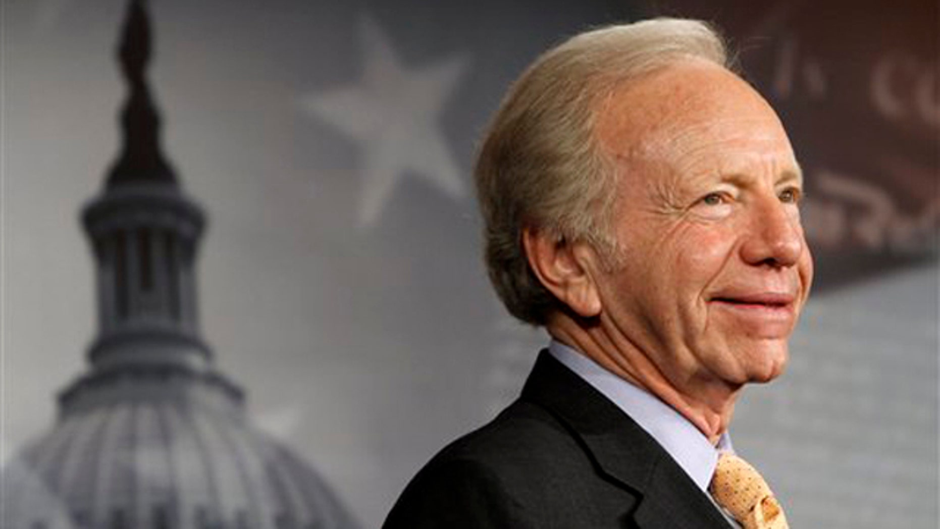 FILE: Jan. 31, 2012: Sen. Joe Lieberman smiles during a news conference on Capitol Hill.