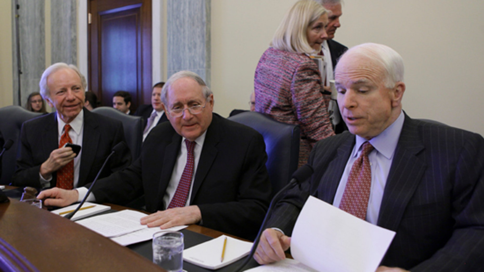Senate Armed Services Committee Sen. Carl Levin, D-Mich., center, flanked by the committee's ranking Republican Sen. John McCain, R-Ariz., right, and Sen. Joseph Lieberman, I-Conn., prepares to open the committee's hearing on U.S. policy toward Iran's nuclear program, Wednesday, April 14, 2010. (AP)