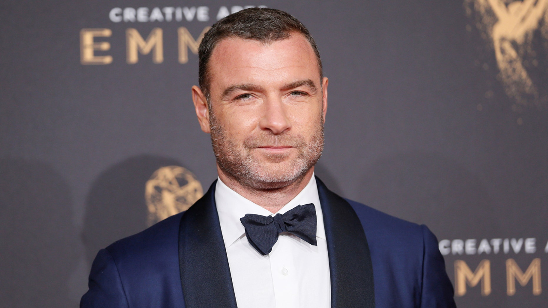 Liev Schreiber poses on the carpet at the 2017 Creative Emmy Awards in Los Angeles.