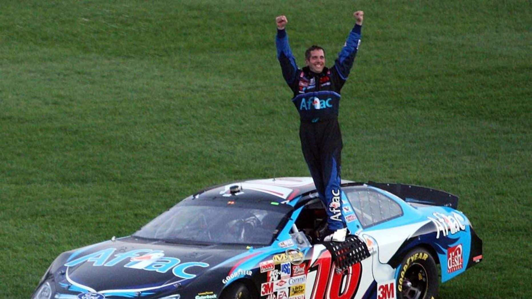 KANSAS CITY, KS - SEPTEMBER 30: Greg Biffle, driver of the #16 Aflac Ford, celebrates after winning the NASCAR Nextel Cup Series LifeLock 400 at Kansas Speedway on September 30, 2007 in Kansas City, Kansas. (Photo by Jamie Squire/Getty Images)