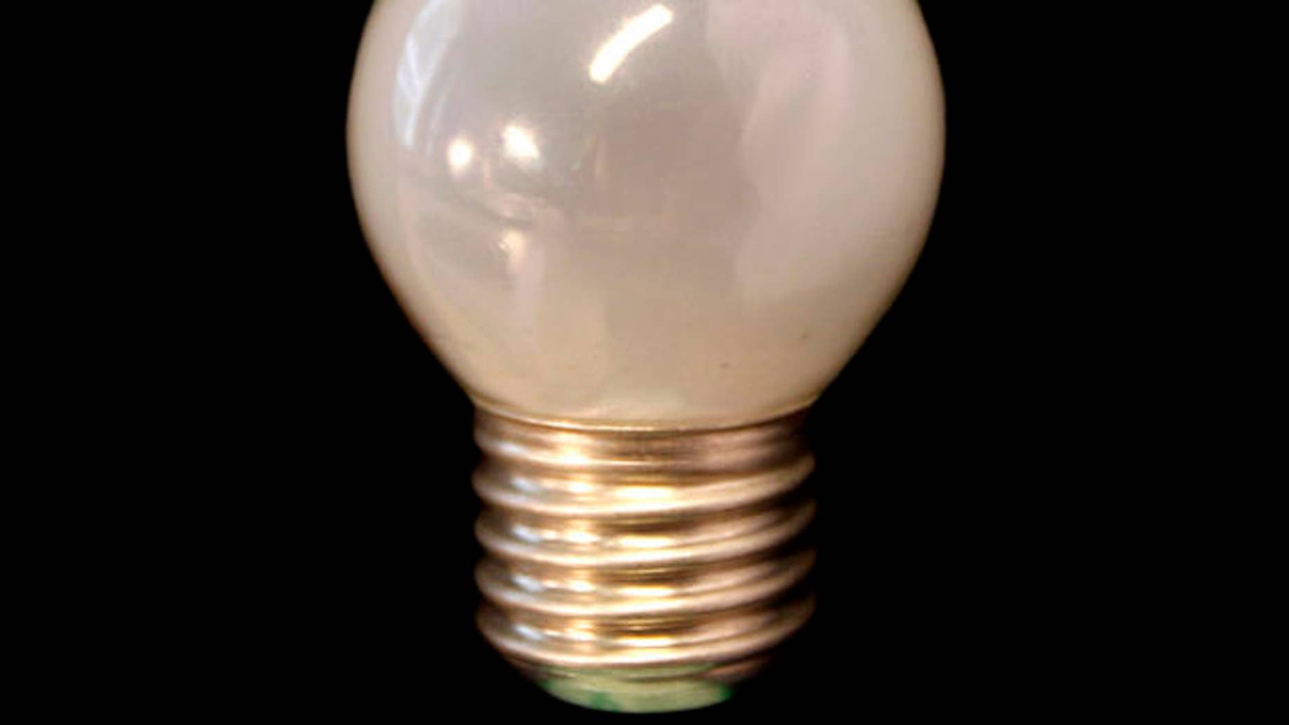 An older style frosted 60 watt incandescent bulb is seen in Brussels, Tuesday Sept. 1, 2009. The EU on Tuesday began making the transition from power-draining lightbulbs to more energy efficient ones. The new EU rules follow an agreement reached by the 27 EU governments last year to phase out the traditional incandescent lightbulb over three years starting this year to help European countries lower greenhouse gas emissions. The older lightbulbs will be replaced by halogen or long-life fluorescent bulbs. (AP Photo/Virginia Mayo)