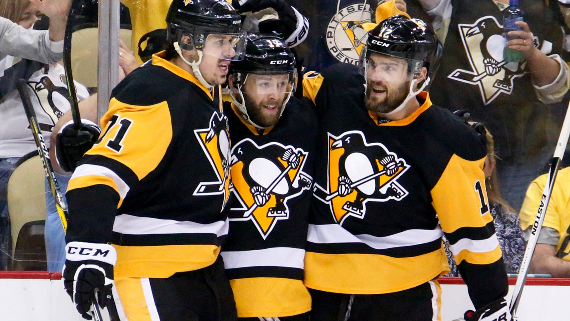 May 26, 2016: Pittsburgh Penguins' Bryan Rust, center, is congratulated by teammates Evgeni Malkin, left, and Ben Lovejoy after scoring against the Tampa Bay Lightning during the second period of Game 7 of the NHL Eastern Conference finals in Pittsburgh.
