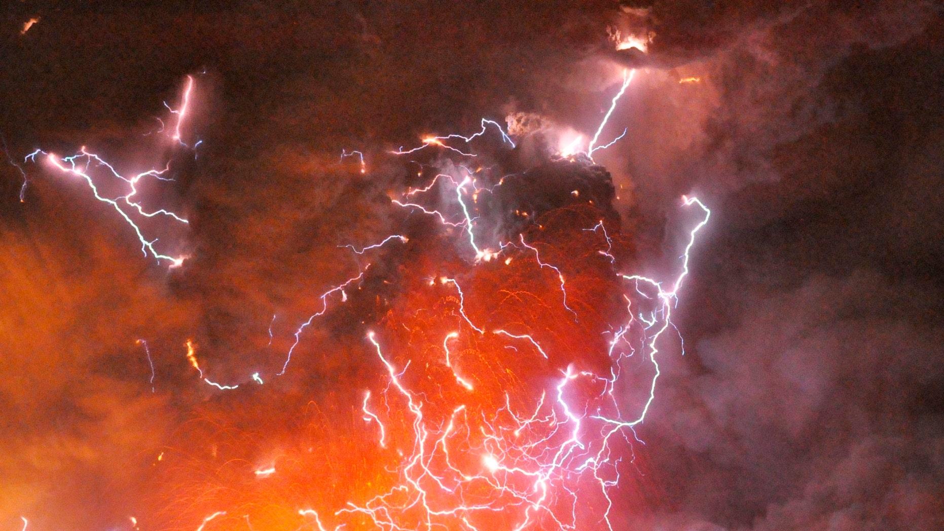 File photo - Volcanic lightning or a dirty thunderstorm is seen above Shinmoedake peak as it erupts, between Miyazaki and Kagoshima prefectures, in this photo taken from Kirishima city and released by Minami-Nippon Shimbun Jan. 28, 2011. (REUTERS/Minami-Nippon Shimbun/Handout)