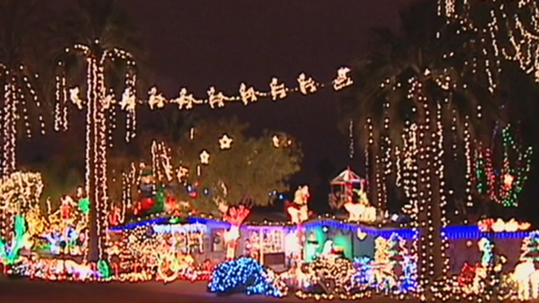 Lee Sepanek says complaints from homeowners and demands from Phoenix officials have discouraged him from setting up his annual Christmas display.
