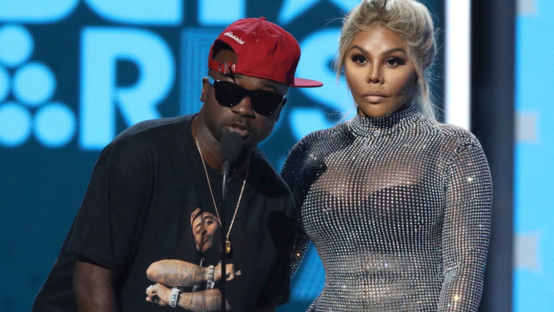 Havoc, left, and Lil Kim present the award for best male hip hop artist at the BET Awards at the Microsoft Theater on Sunday, June 25, 2017, in Los Angeles.