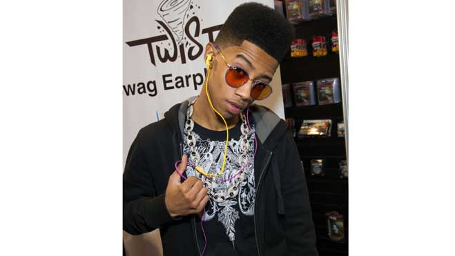 Jan. 10, 2013: In this publicity image originally released by Nikura USA, Hip hop artist, Lil Twist, born Christopher Moore, debuts his new headphone collection at International CES 2013 in Las Vegas, Nev.