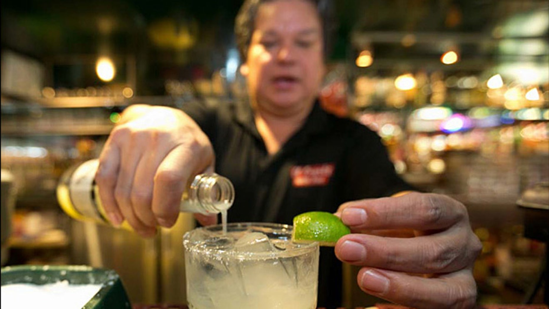 Bartender Mario Sanchez crafts a margarita cocktail at the bar of El Coyote, a Mexican restaurant in Los Angeles.