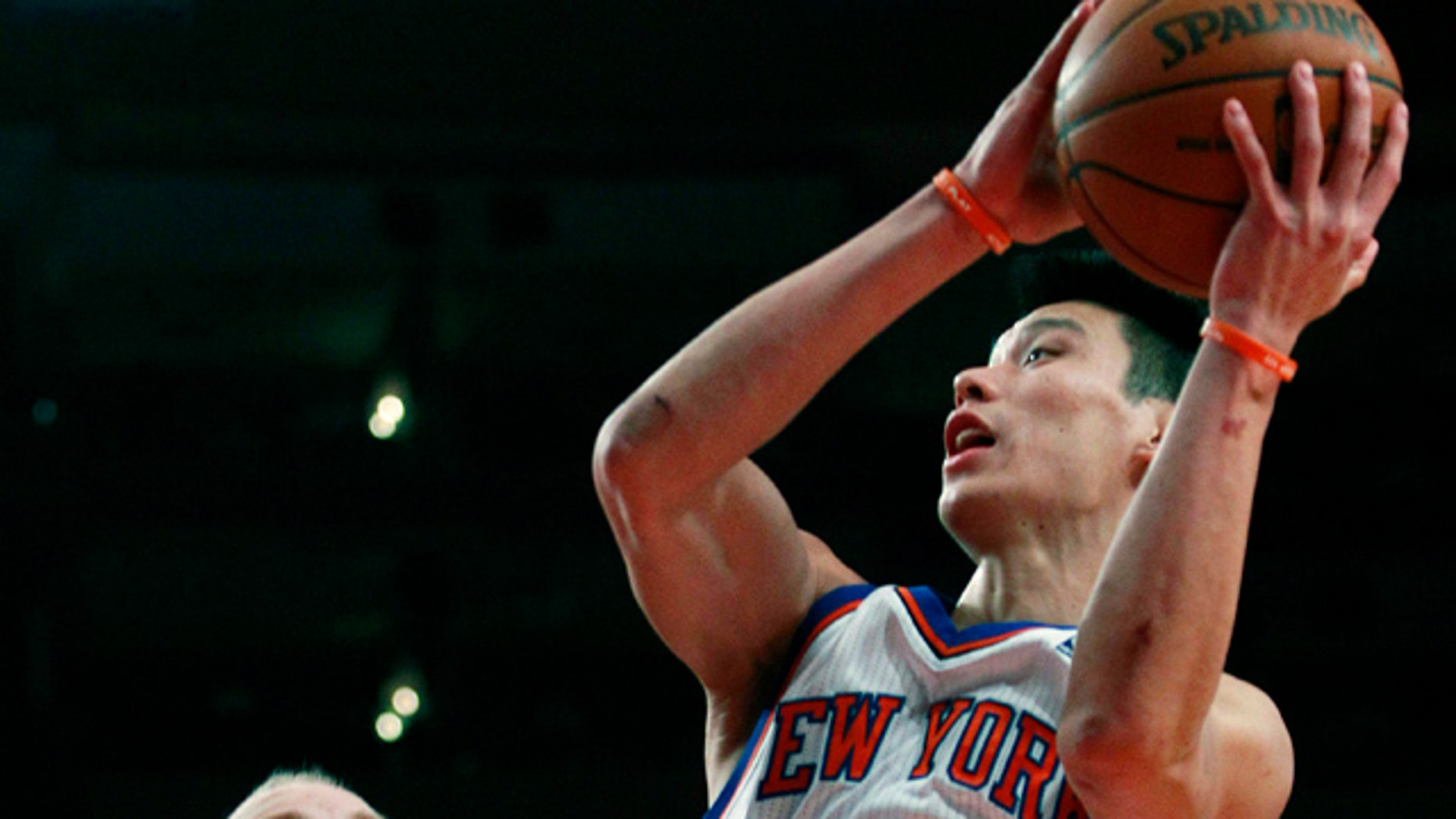 Feb. 17: New York Knicks' Jeremy Lin (17) drives against New Orleans Hornets' Chris Kaman during the first half of an NBA basketball game in New York.