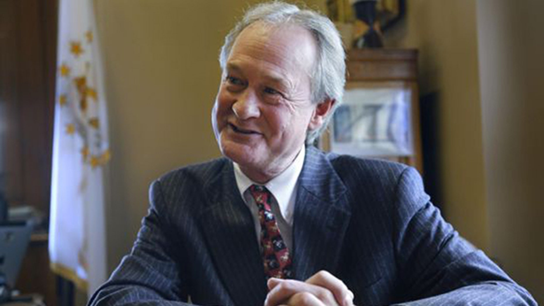 In this file photo, then-Rhode Island Gov. Lincoln Chafee responds to questions during an interview with The Associated Press, in his office at the Statehouse, in Providence, R.I.
